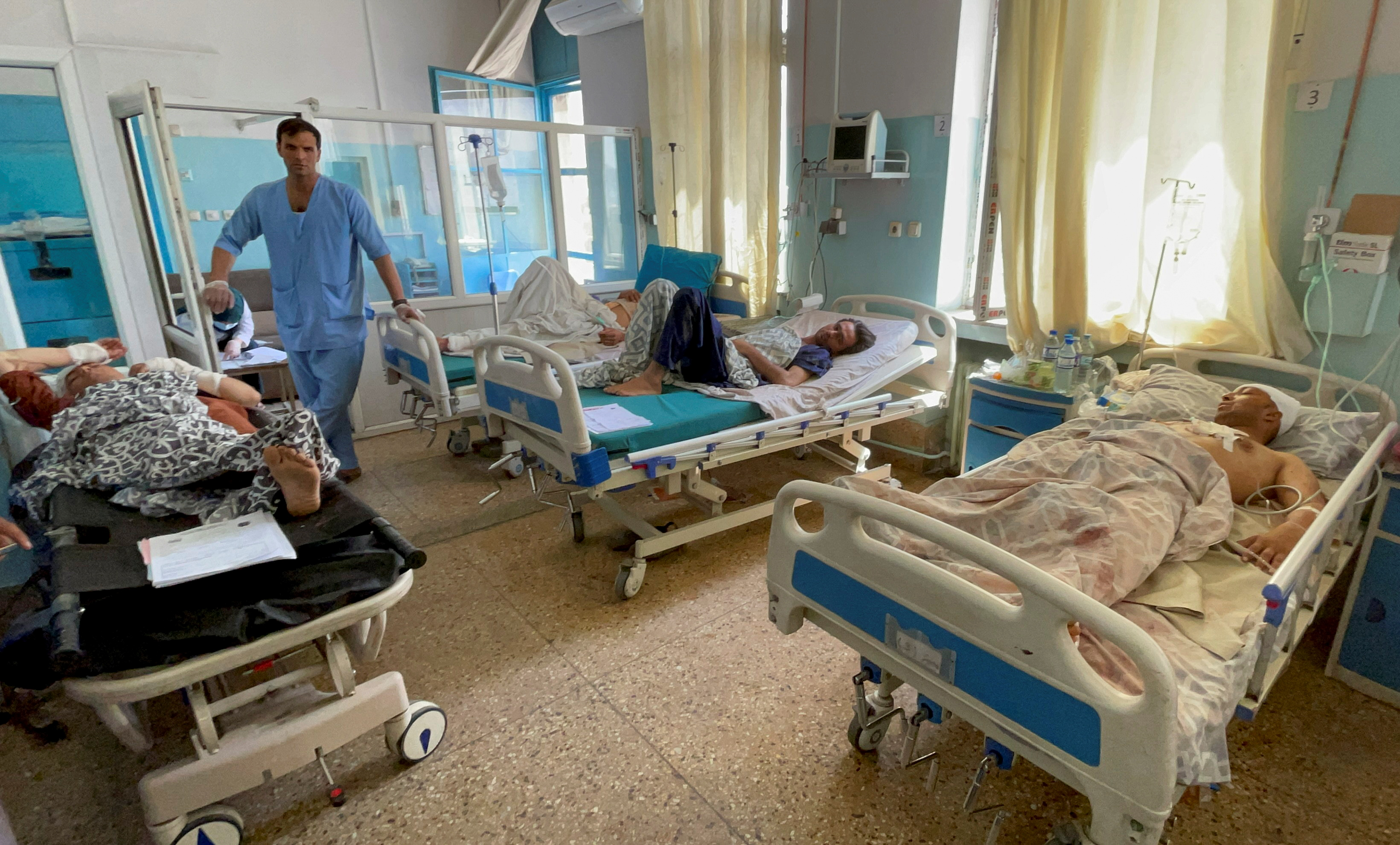 Wounded Afghan men receive treatment at a hospital after yesterday's explosions outside airport in Kabul, Afghanistan August 27, 2021. REUTERS/Stringer