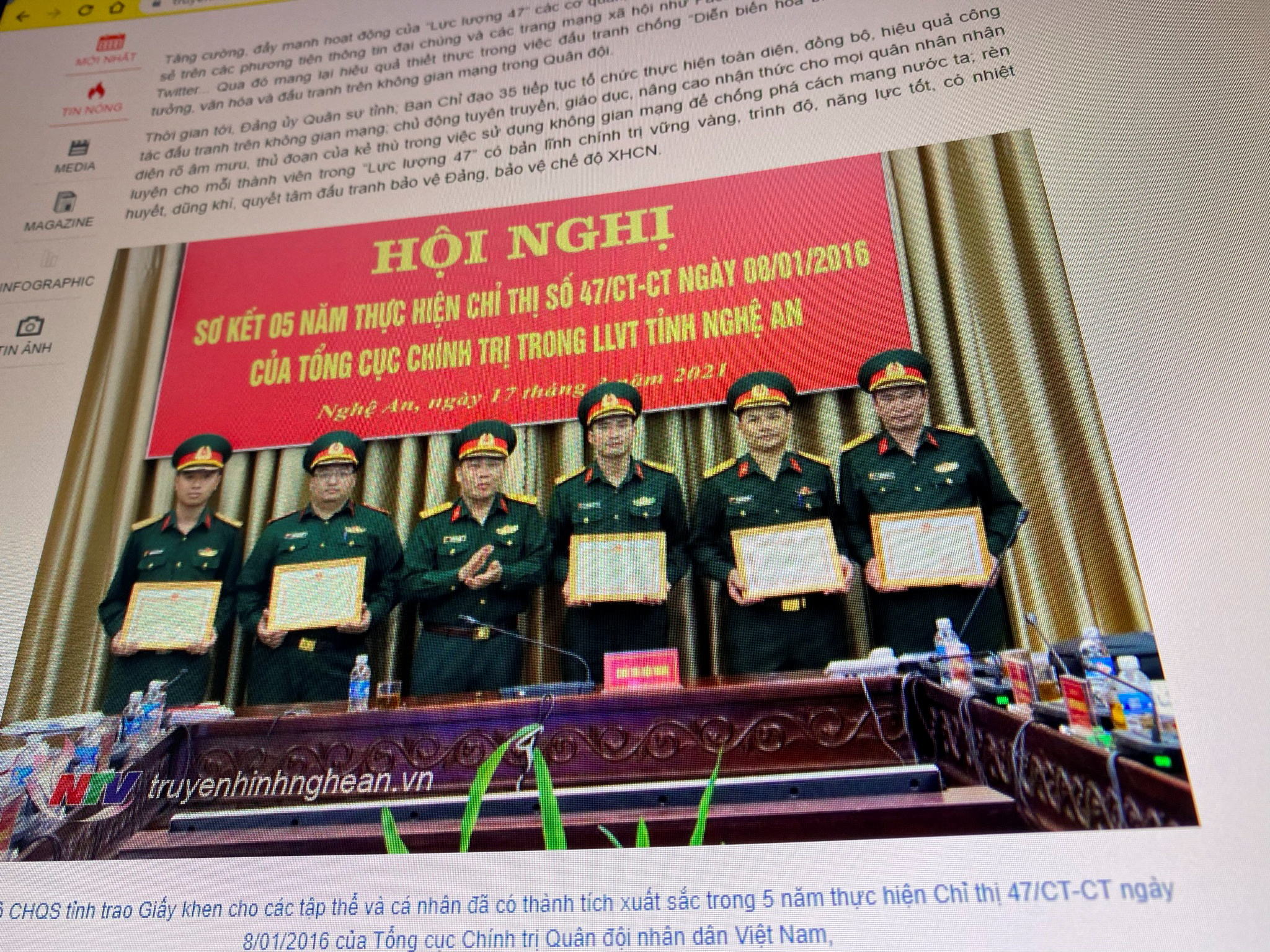 A state media article from March 17, 2021 with a picture of soldiers belonging to the Nghe An provincial branch of Vietnam's 'Force 47' cyber army who were awarded certificates for carrying out Force 47 activities is displayed on screen in this picture takenJuly 8, 2021. TRUYENHINHNGHEAN.VN via REUTERS