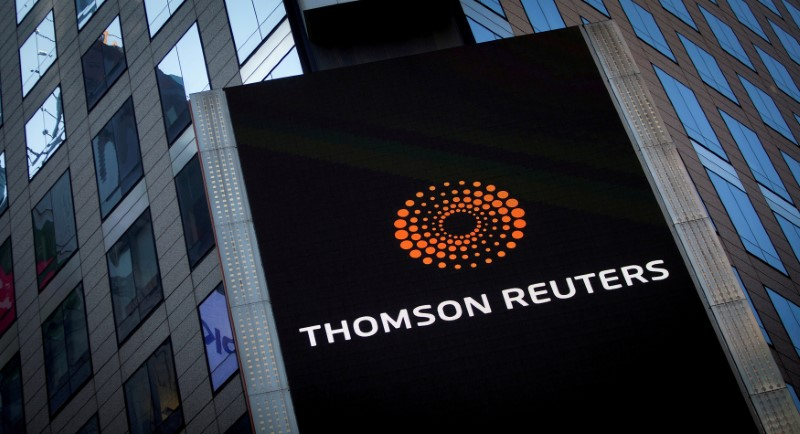 The Thomson Reuters logo is seen on the company building in Times Square, New York.  REUTERS/Carlo Allegri