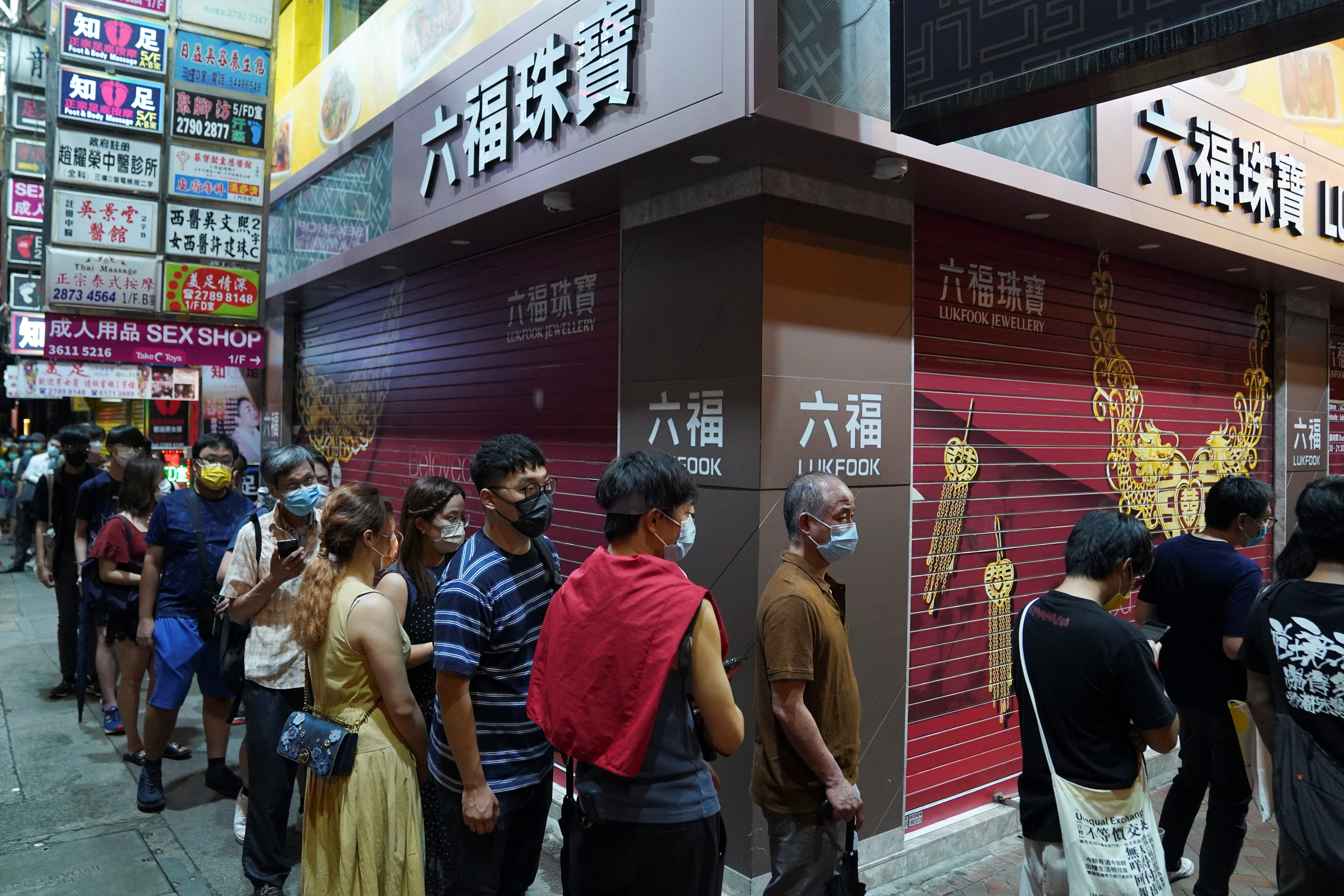 People queue to buy copies of the final edition of Apple Daily, published by Next Digital, in Hong Kong, China June 24, 2021. REUTERS/Lam Yik