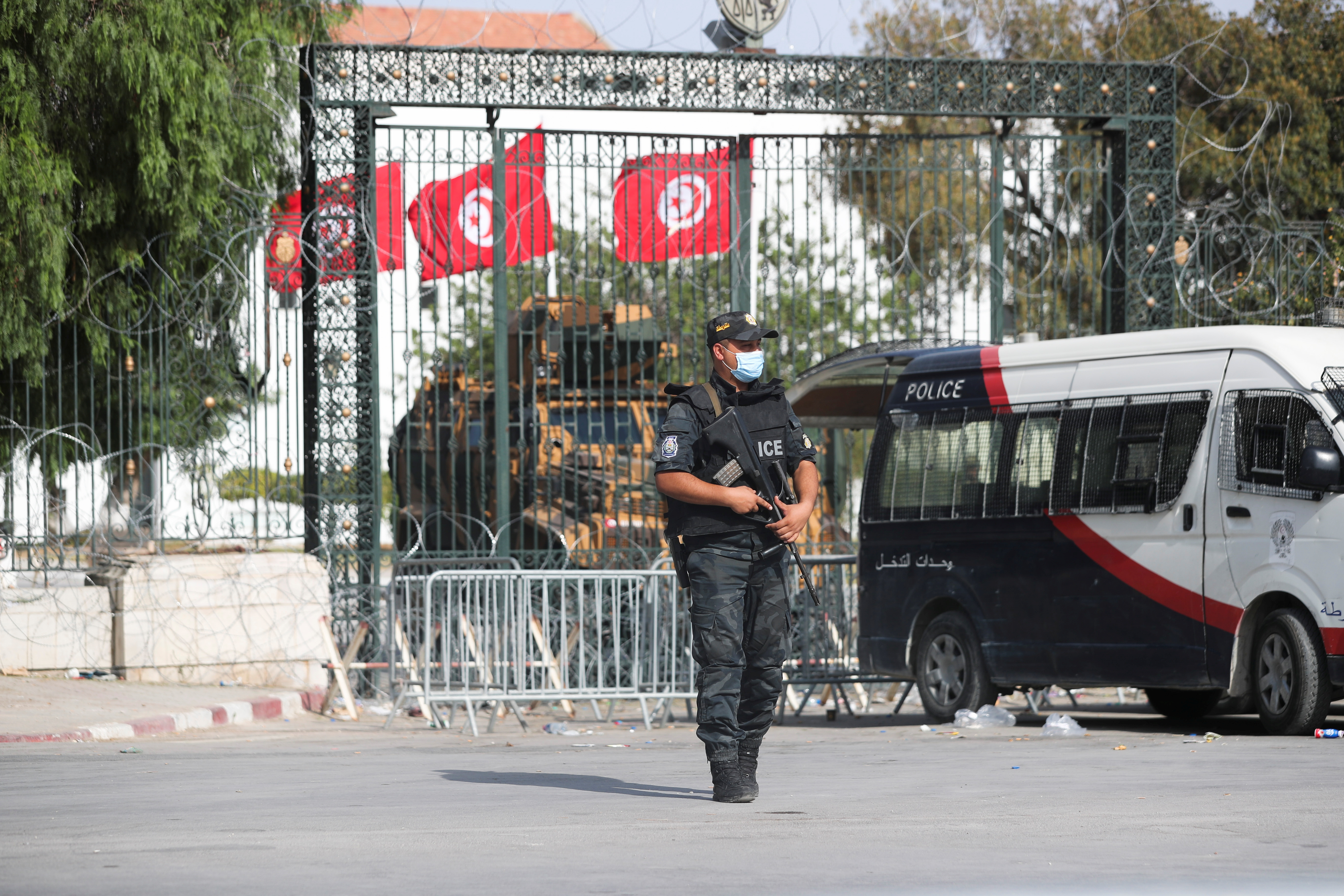 A police officer stands guard outside the parliament building in Tunis,Tunisia July 29, 2021. REUTERS/Ammar Awad