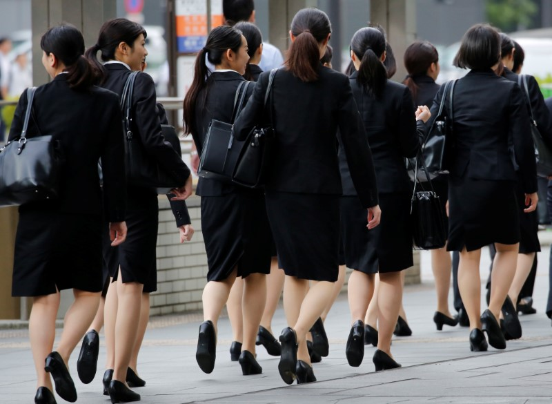 Female office workers wearing high heels, clothes and bags of the same colour make their way at a business district in Tokyo, Japan, June 4, 2019. REUTERS/Kim Kyung-Hoon/Files