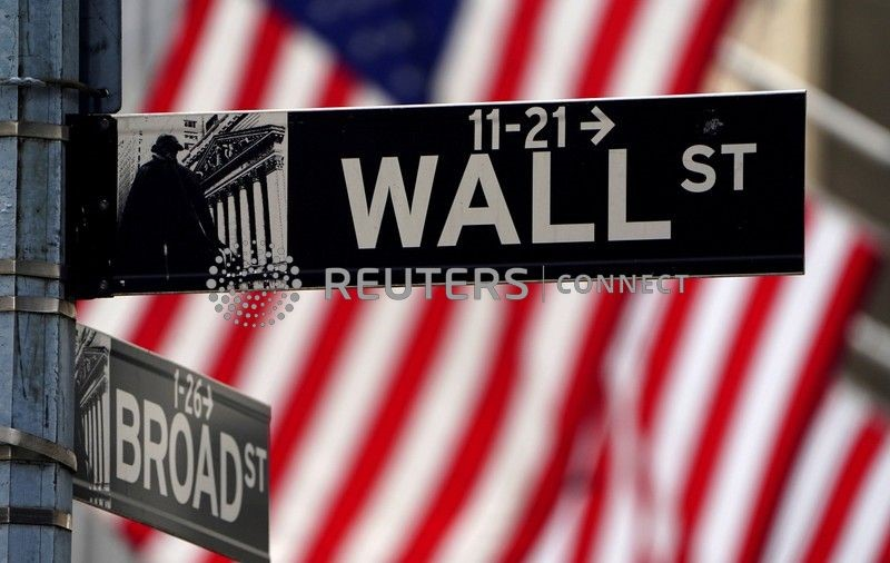 A Wall Street sign is pictured outside the New York Stock Exchange amid the coronavirus disease (COVID-19) pandemic in the Manhattan borough of New York City, New York, U.S., April 16, 2021. REUTERS/Carlo Allegri/File Photo