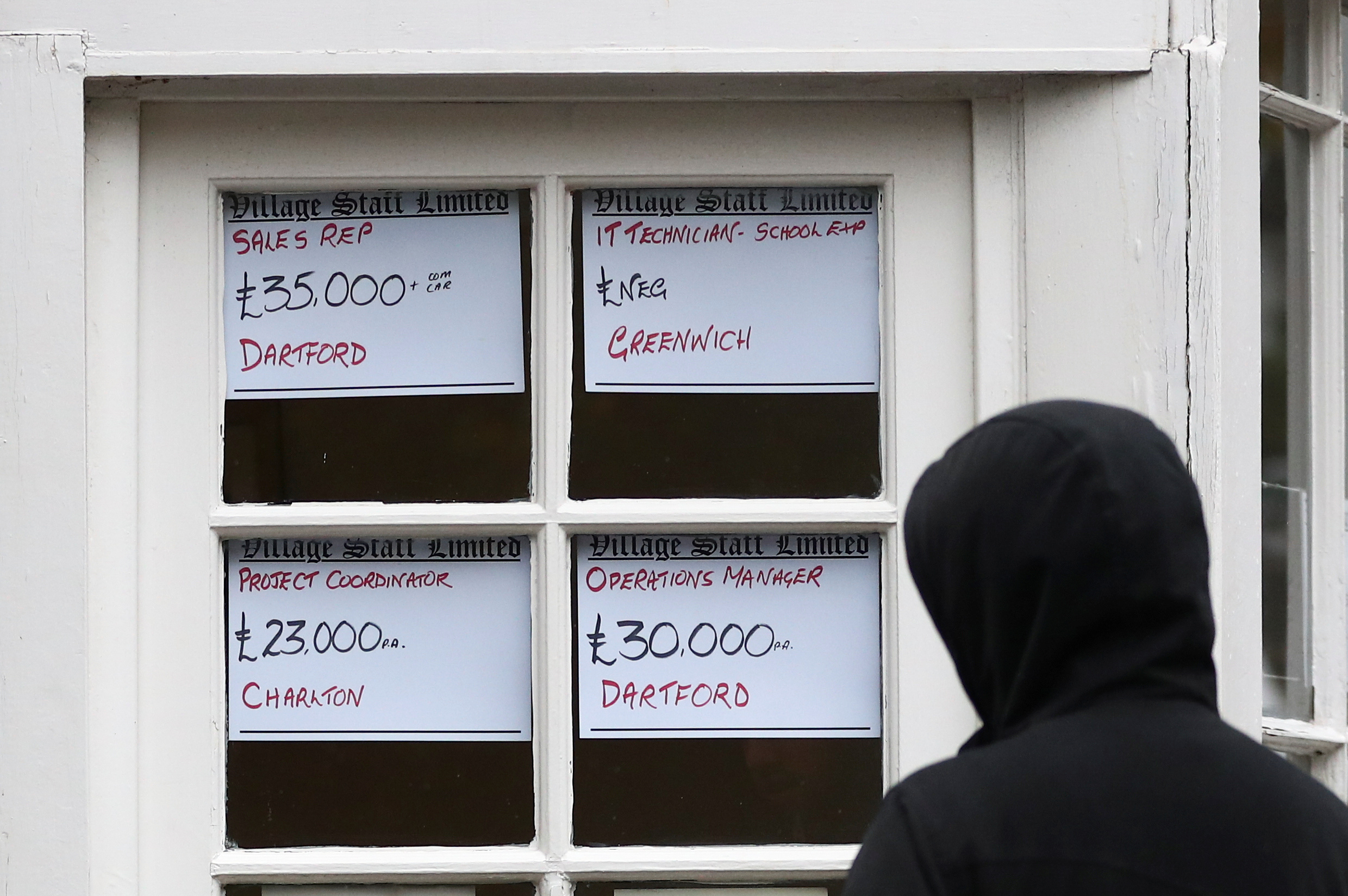 A person looks at the adverts in the window of a job agency in London, Britain October 13, 2020. REUTERS/Hannah McKay