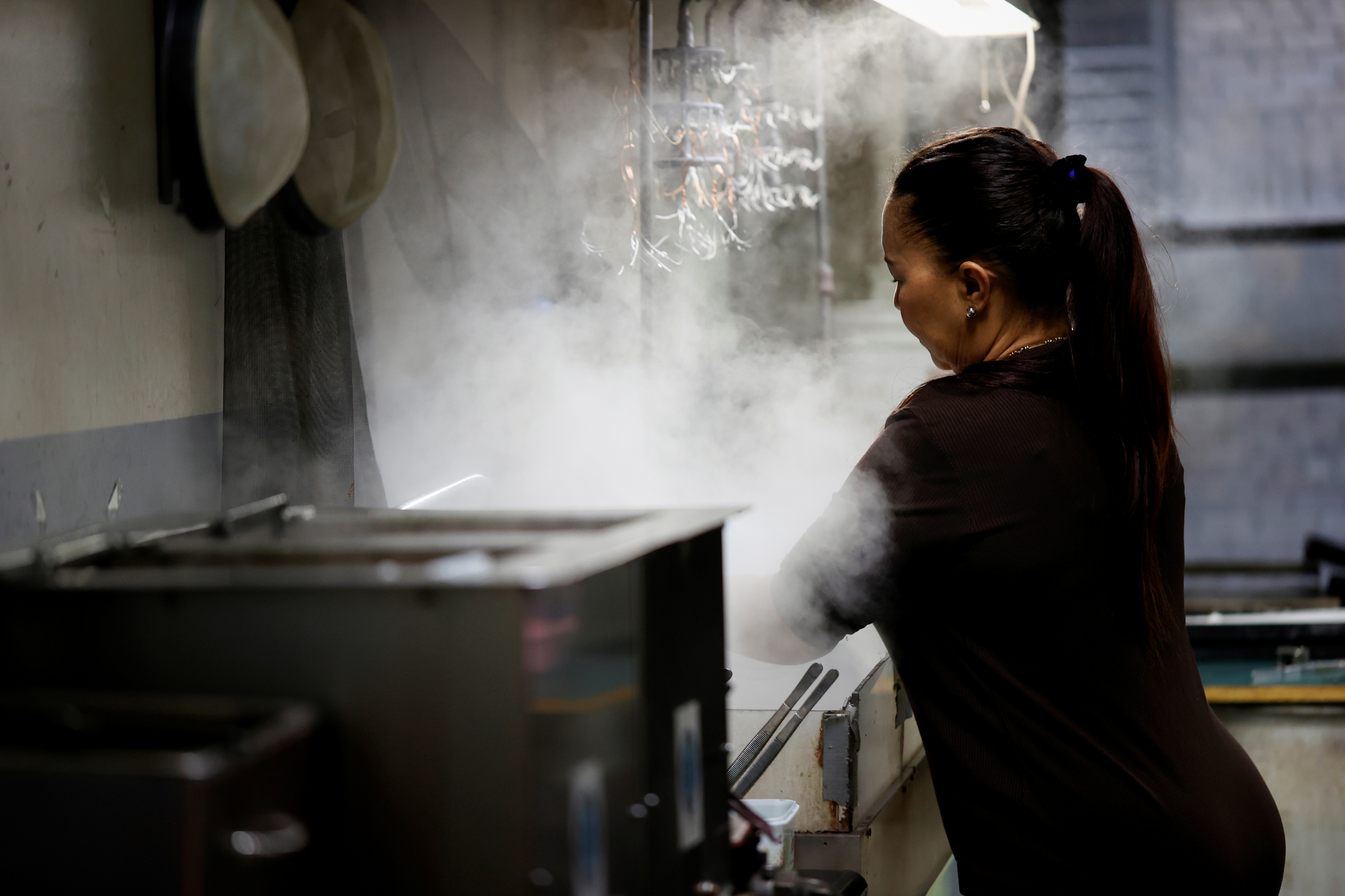 A Jewelry worker works at a steam cleaning machine in a workshop at RFG Manufacturing Riviera jewelry design facility in Manhattan in New York City, New York, U.S., September 30, 2021. Picture taken September 30, 2021.  REUTERS Mike Segar