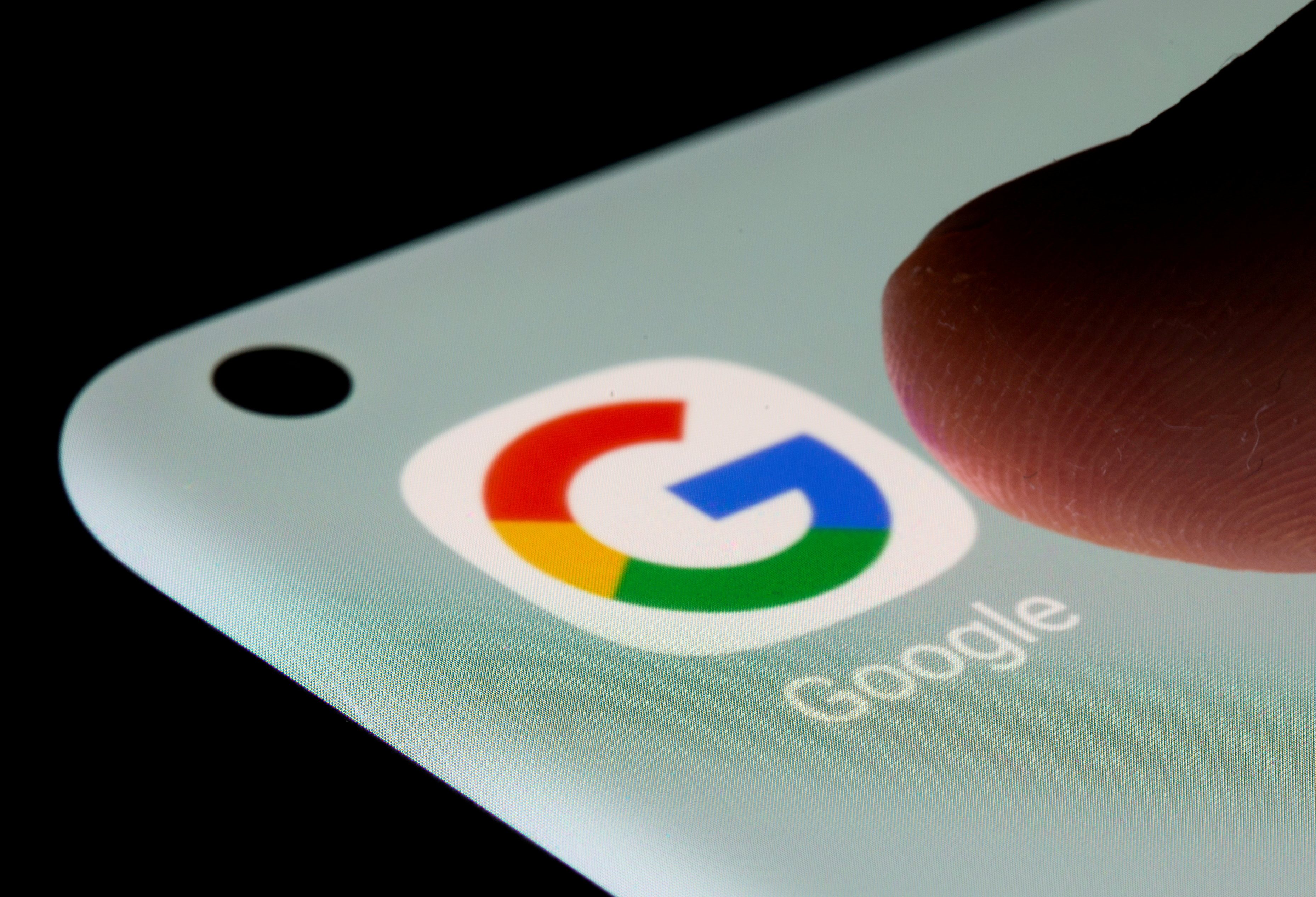 Google app is seen on a smartphone in this illustration taken, July 13, 2021. REUTERS/Dado Ruvic/Illustration//File Photo