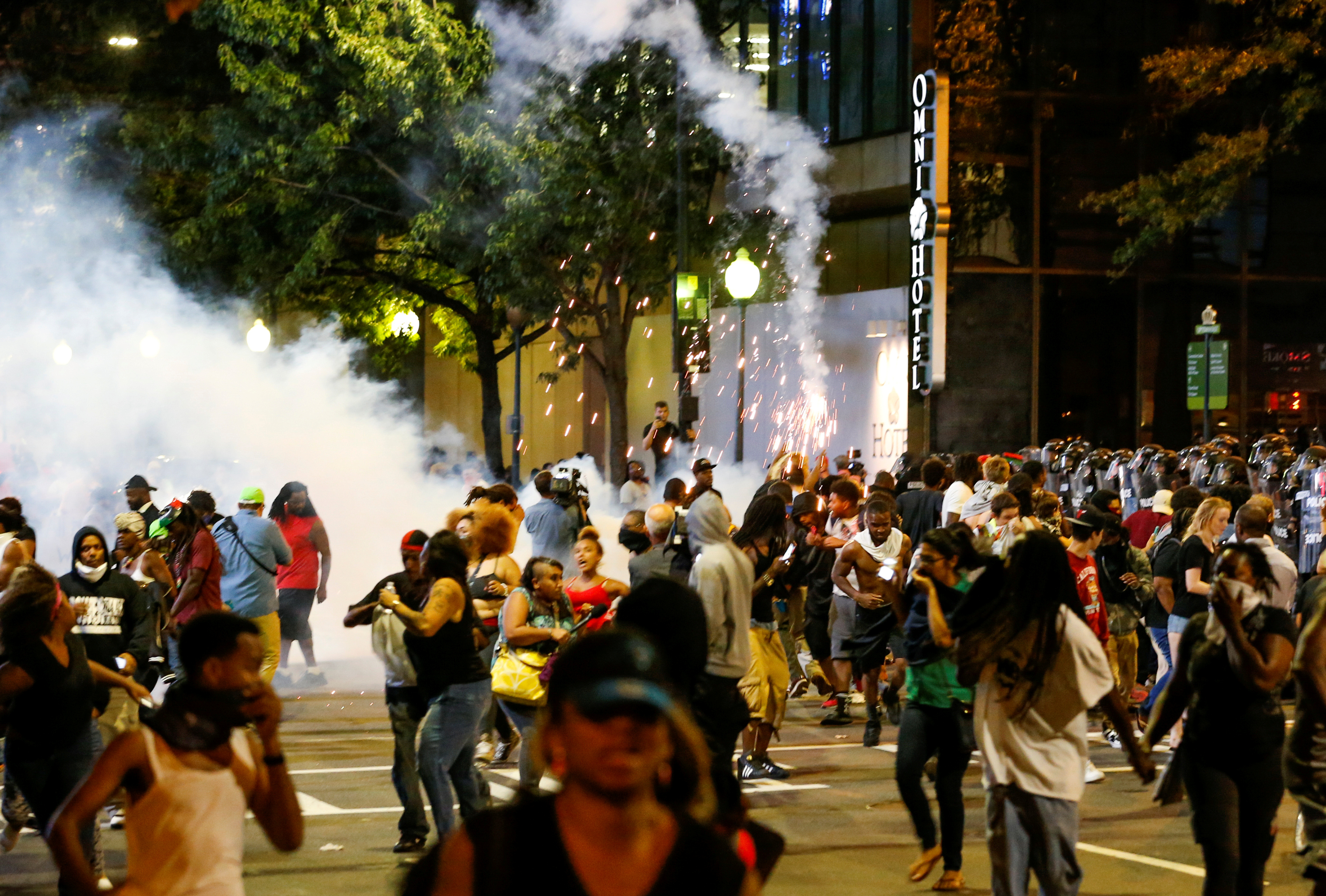 People run from flash-bang grenades in uptown Charlotte, NC during a protest of the police shooting of Keith Scott, in Charlotte, North Carolina, U.S. September 21, 2016. REUTERS/Jason Miczek/File Photo