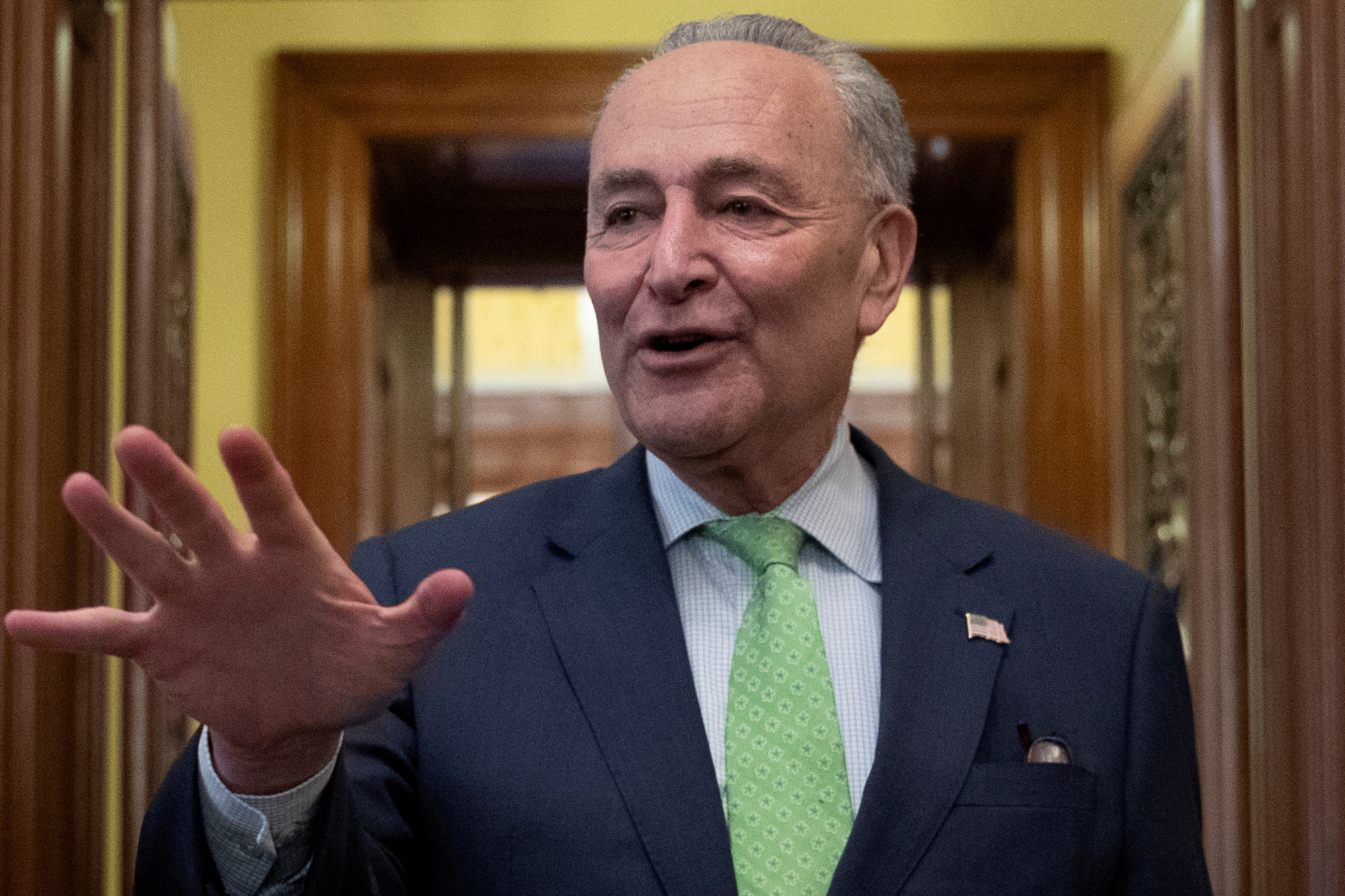 Senate Majority Leader Chuck Schumer (D-NY) speaks to news reporters following the announcement of a bipartisan deal on infrastructure, on Capitol Hill in Washington, U.S., June 24, 2021.  REUTERS/Tom Brenner/File Photo