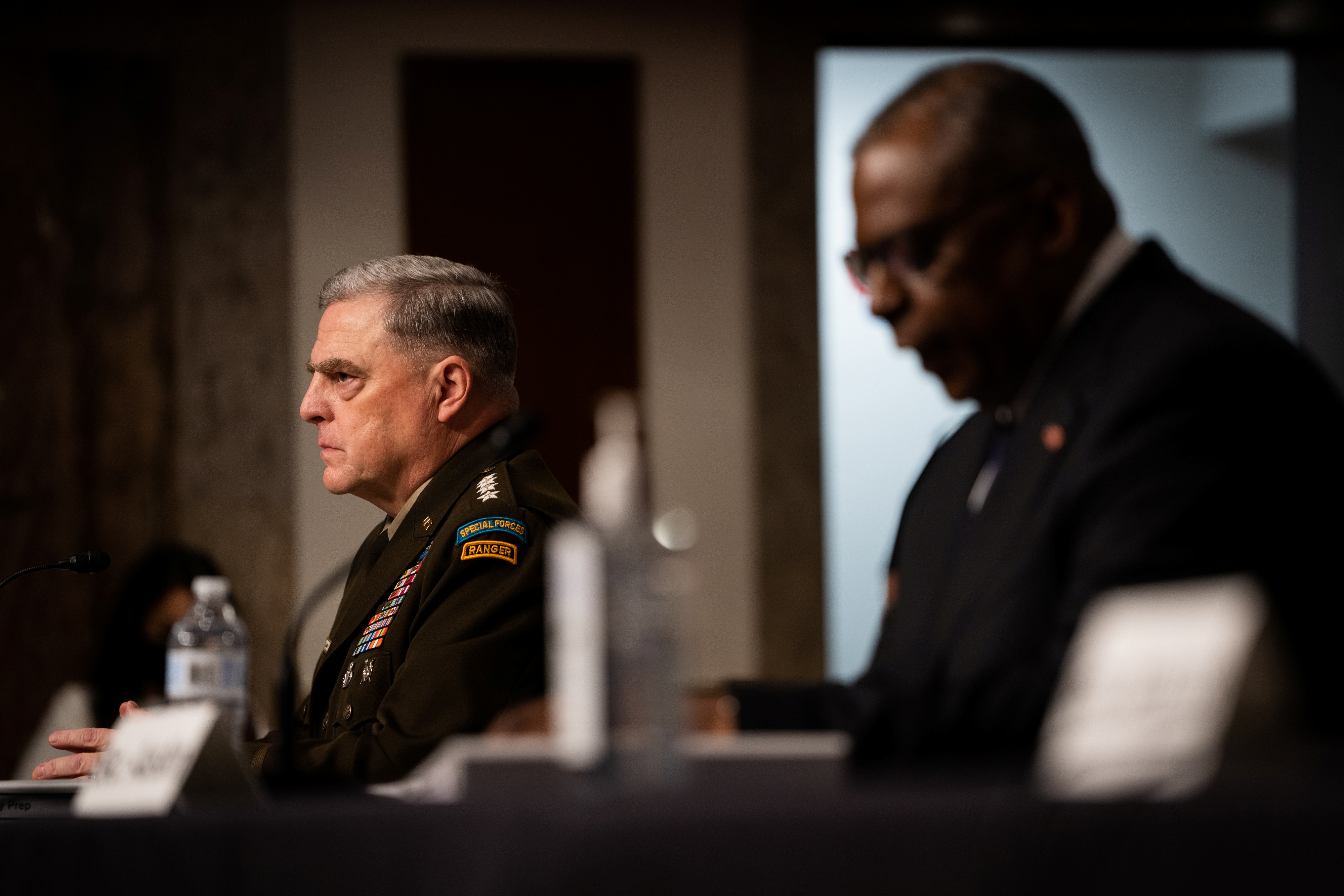 Chairman of the Joint Chiefs of Staff General Mark Milley and U.S. Defense Secretary Lloyd Austin testify during a Senate Armed Services Committee hearing on the conclusion of military operations in Afghanistan and plans for future counterterrorism operations, on Capitol Hill in Washington, U.S., September 28, 2021. Sarahbeth Maney/Pool via REUTERS