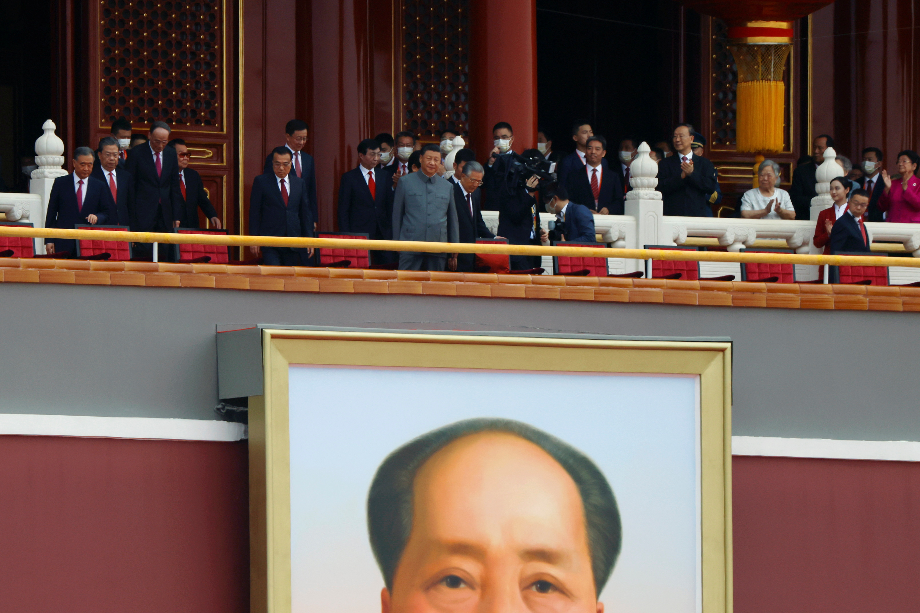 Chinese President Xi Jinping stands above a giant portrait of late Chinese chairman Mao Zedong as he arrives for the event marking the 100th founding anniversary of the Communist Party of China, on Tiananmen Square in Beijing, China July 1, 2021. REUTERS/Carlos Garcia Rawlins - RC2BBO92BEIT