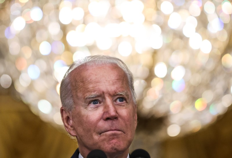 U.S. President Joe Biden takes questions as he discusses the U.S. Senate's passage of the $1 trillion bipartisan infrastructure bill, in the East Room at the White House in Washington, U.S., August 10, 2021. REUTERS/Evelyn Hockstein