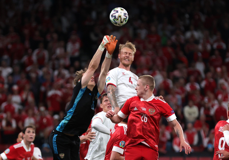 Soccer Football - Euro 2020 - Group B - Russia v Denmark - Parken Stadium, Copenhagen, Denmark - June 21, 2021  Denmark's Simon Kjaer in action with Russia's Matvei Safonov Pool via REUTERS/Friedemann Vogel
