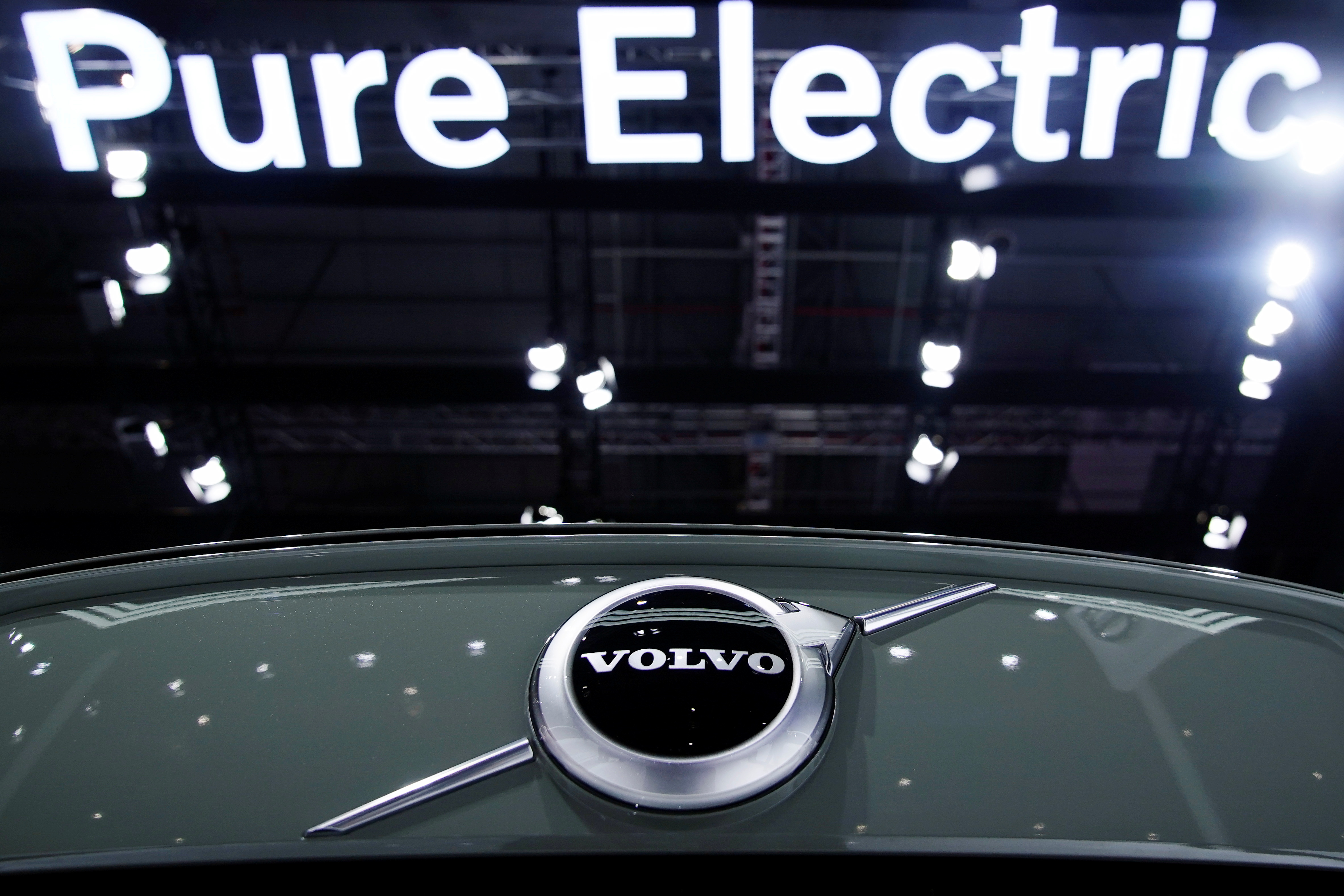 A Pure Electric sign is seen above a Volvo vehicle displayed during a media day for the Auto Shanghai show in Shanghai, China April 20, 2021. REUTERS/Aly Song/Files