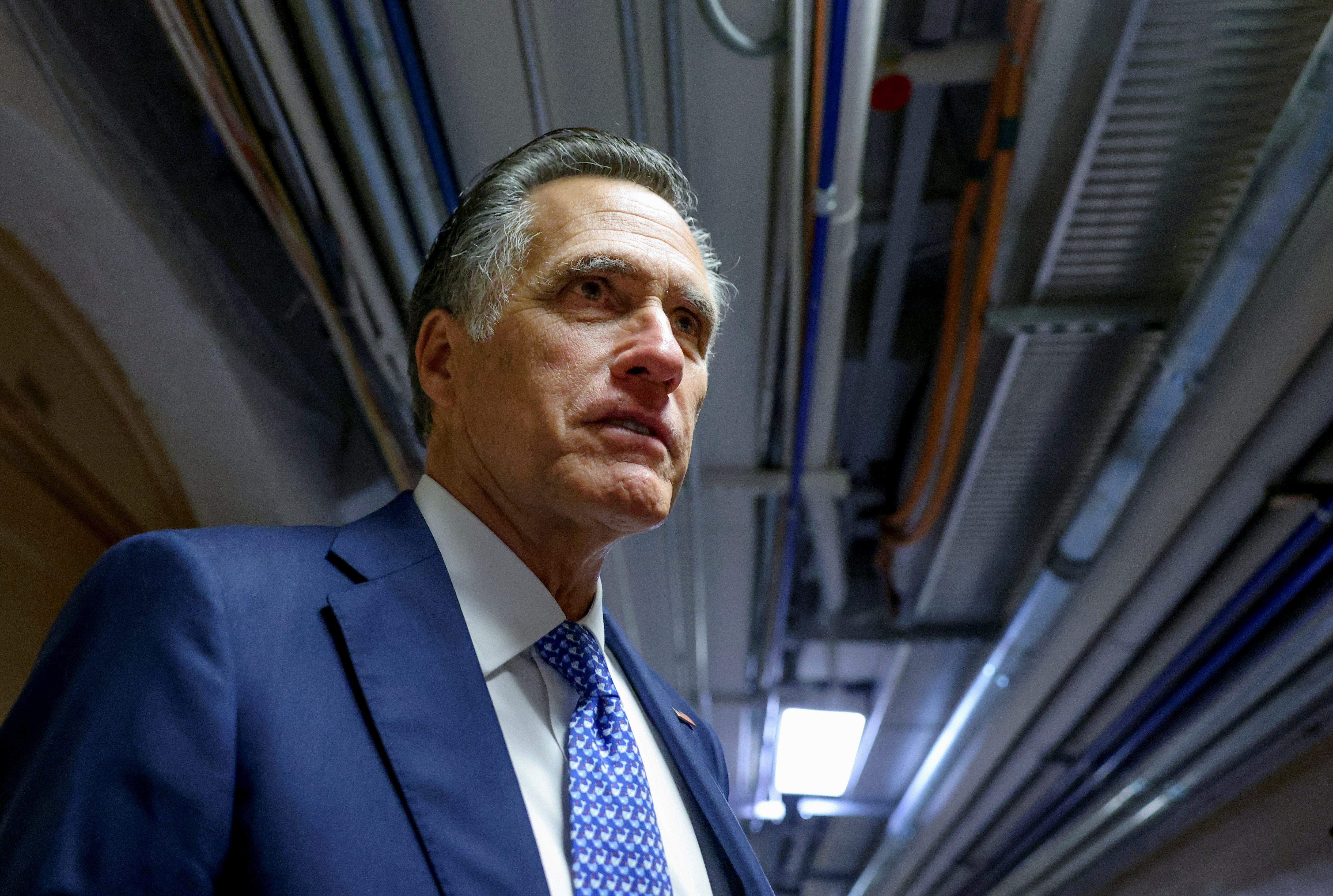 U.S. Senator Mitt Romney (R-UT) looks on as he departs after attending a bipartisan work group meeting on an infrastructure bill at the U.S. Capitol in Washington, U.S., June 8, 2021. REUTERS/Evelyn Hockstein
