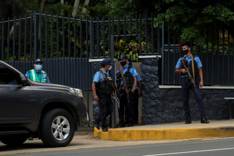 Nicaraguan police officers keep watch at the entrance to the house of opposition leader Cristiana Chamorro after prosecutors sought her arrest for money laundering and other crimes, according to judicial authorities, in Managua, Nicaragua June 2, 2021. REUTERS/Carlos Herrera
