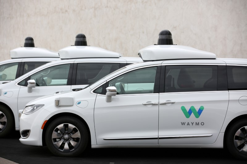 Three of the fleet of 600 Waymo Chrysler Pacifica Hybrid self-driving vehicles are parked and displayed during a demonstration in Chandler, Arizona, November 29, 2018. REUTERS/Caitlin O'Hara
