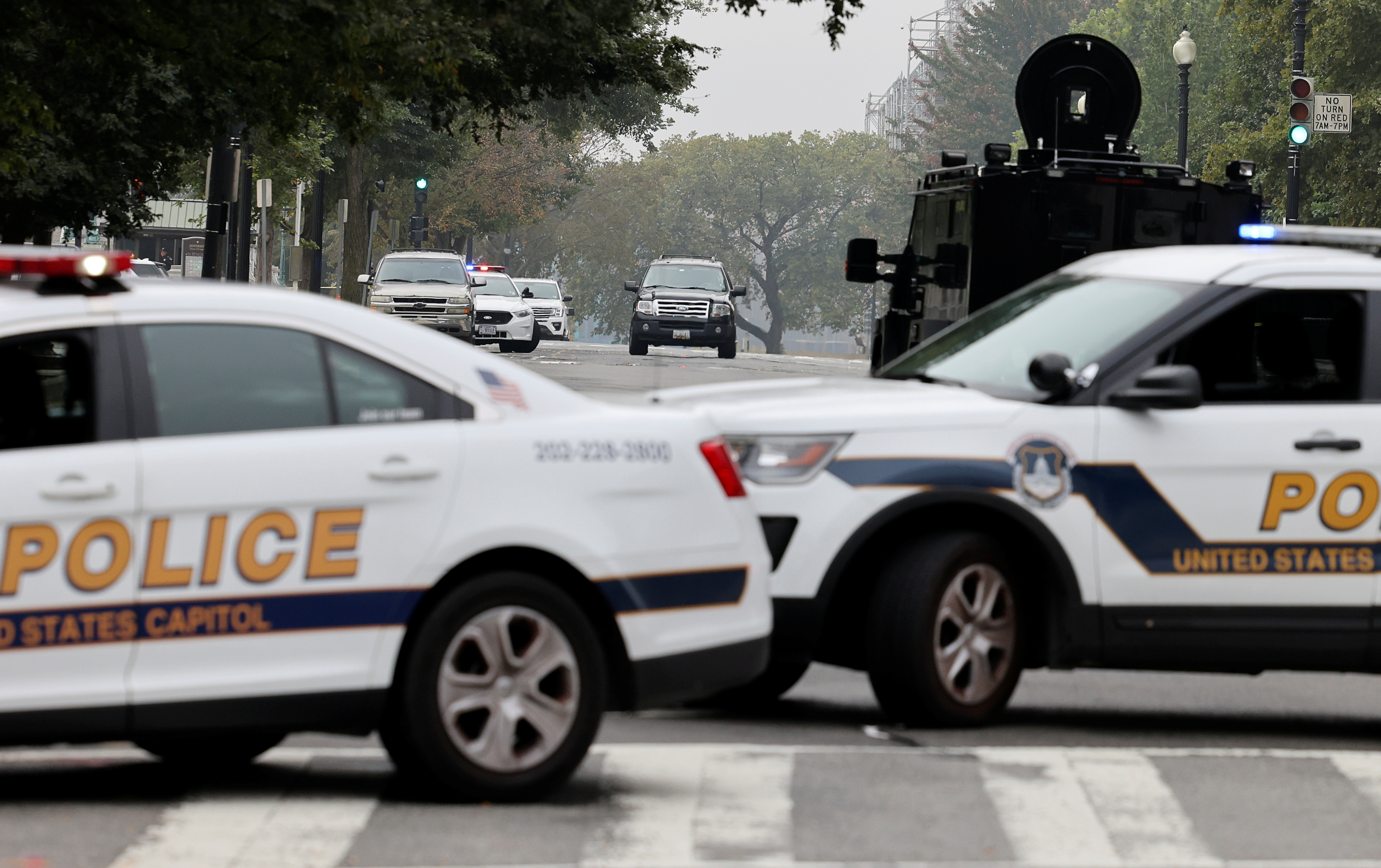 U.S. Capitol Police vehicles block a street as they investigate a suspicious vehicle (C) in front of the U.S. Supreme Court in Washington, U.S., October 5, 2021. REUTERS/Evelyn Hockstein