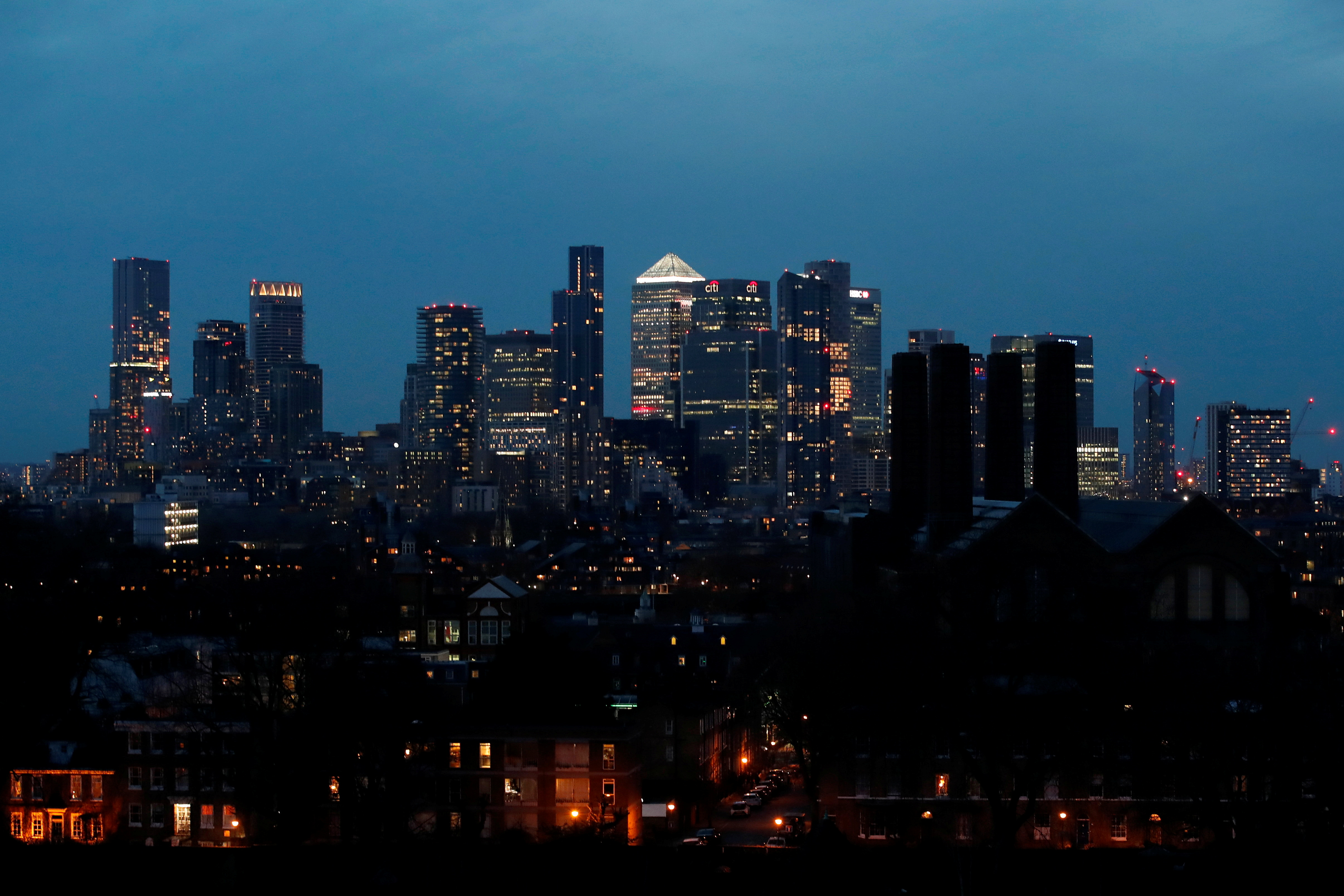 View of Canary Wharf business district at dusk in London, Britain March 9, 2021. REUTERS/Peter Cziborra/File photo