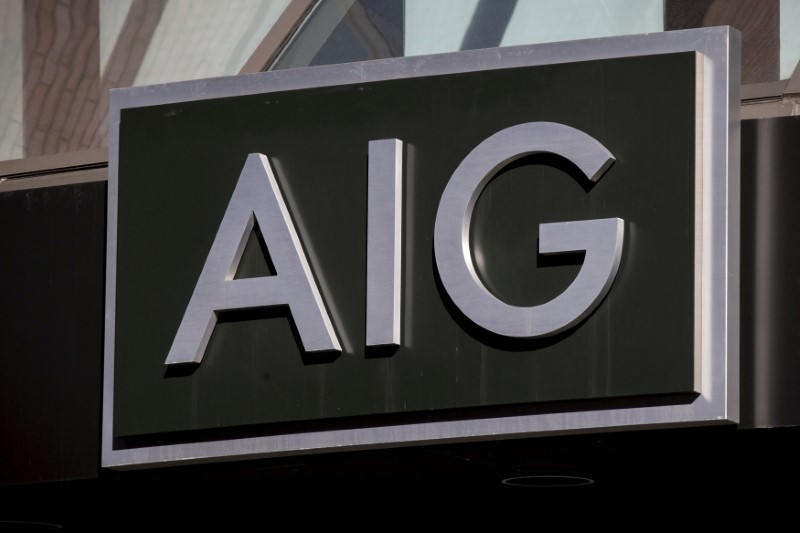 The AIG logo is seen at its building in New York's financial district March 19, 2015. REUTERS/Brendan McDermid//File Photo