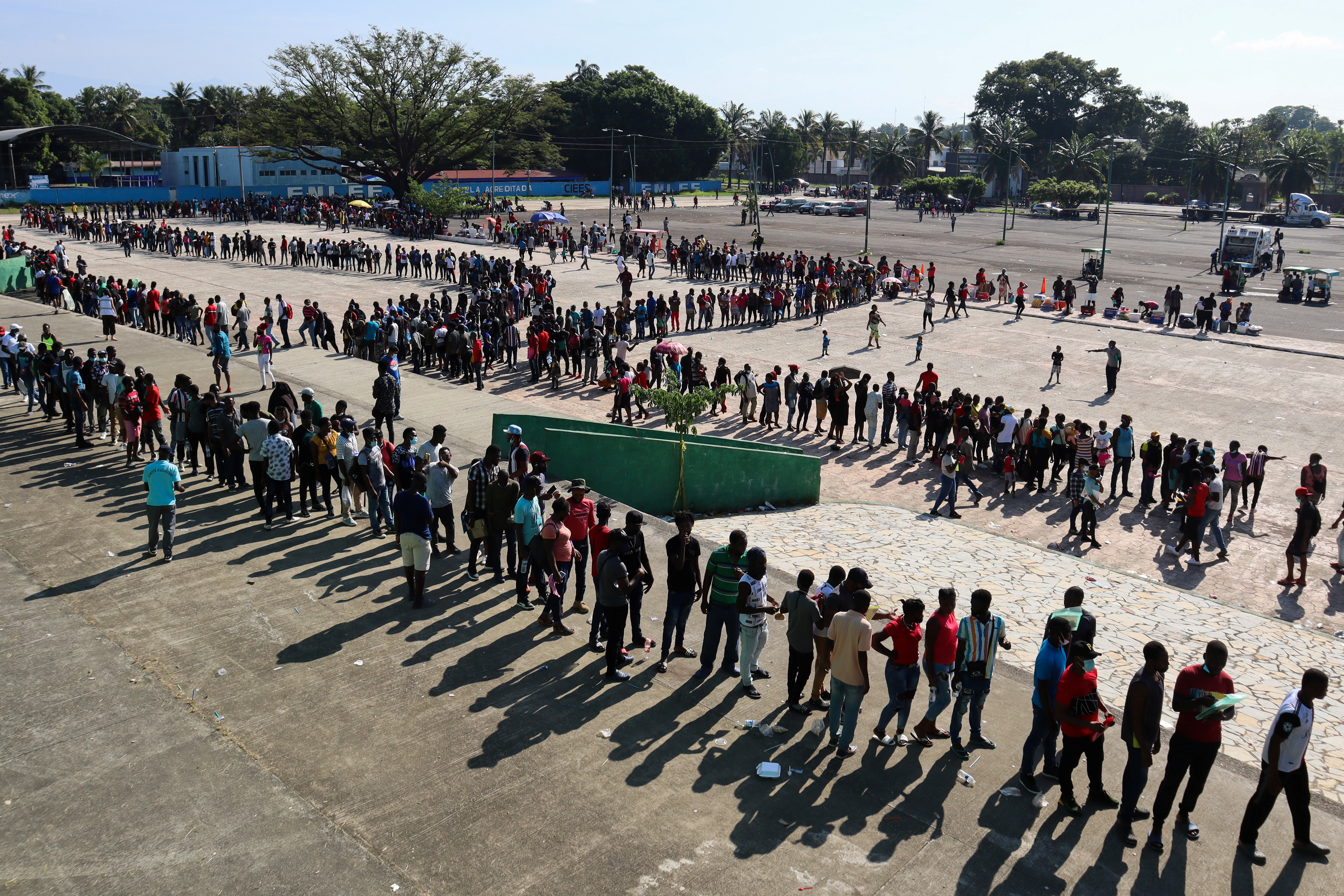 Migrants, mostly Haitians, wait for asylum processing by Mexico's Commission for Refugee Assistance (COMAR) outside a soccer stadium, in Tapachula, Mexico October 12, 2021. REUTERS/Jose Torres