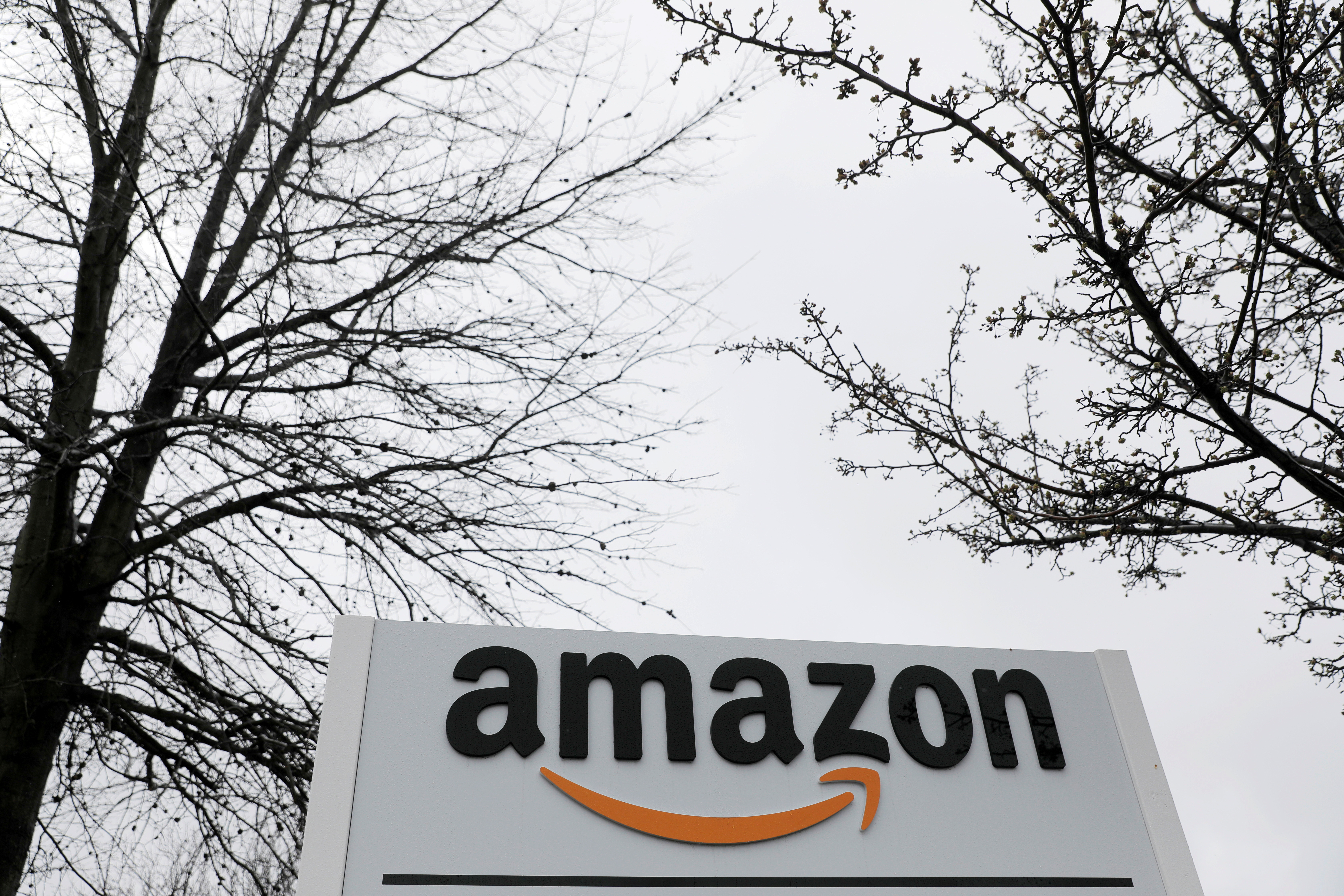 Signage is seen at an Amazon facility in Bethpage on Long Island in New York, U.S., March 17, 2020. REUTERS/Andrew Kelly/File Photo