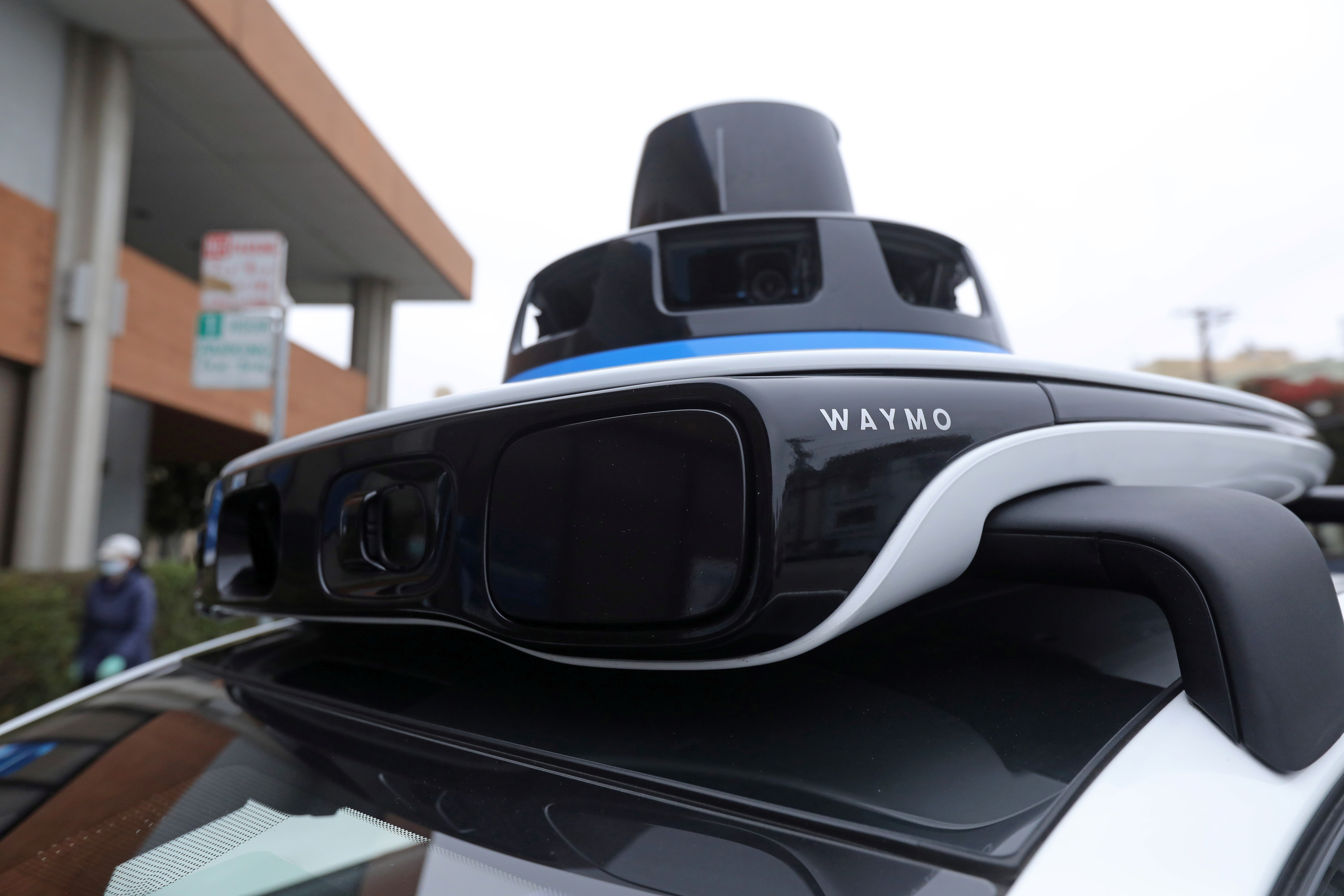 The 360 vision system with its cameras, radar panels and lidar sits atop Waymo's all-electric Jaguar I-Pace SUV in San Francisco, California, U.S., August 20, 2021. Picture taken August 20, 2021. REUTERS/Nathan Frandino