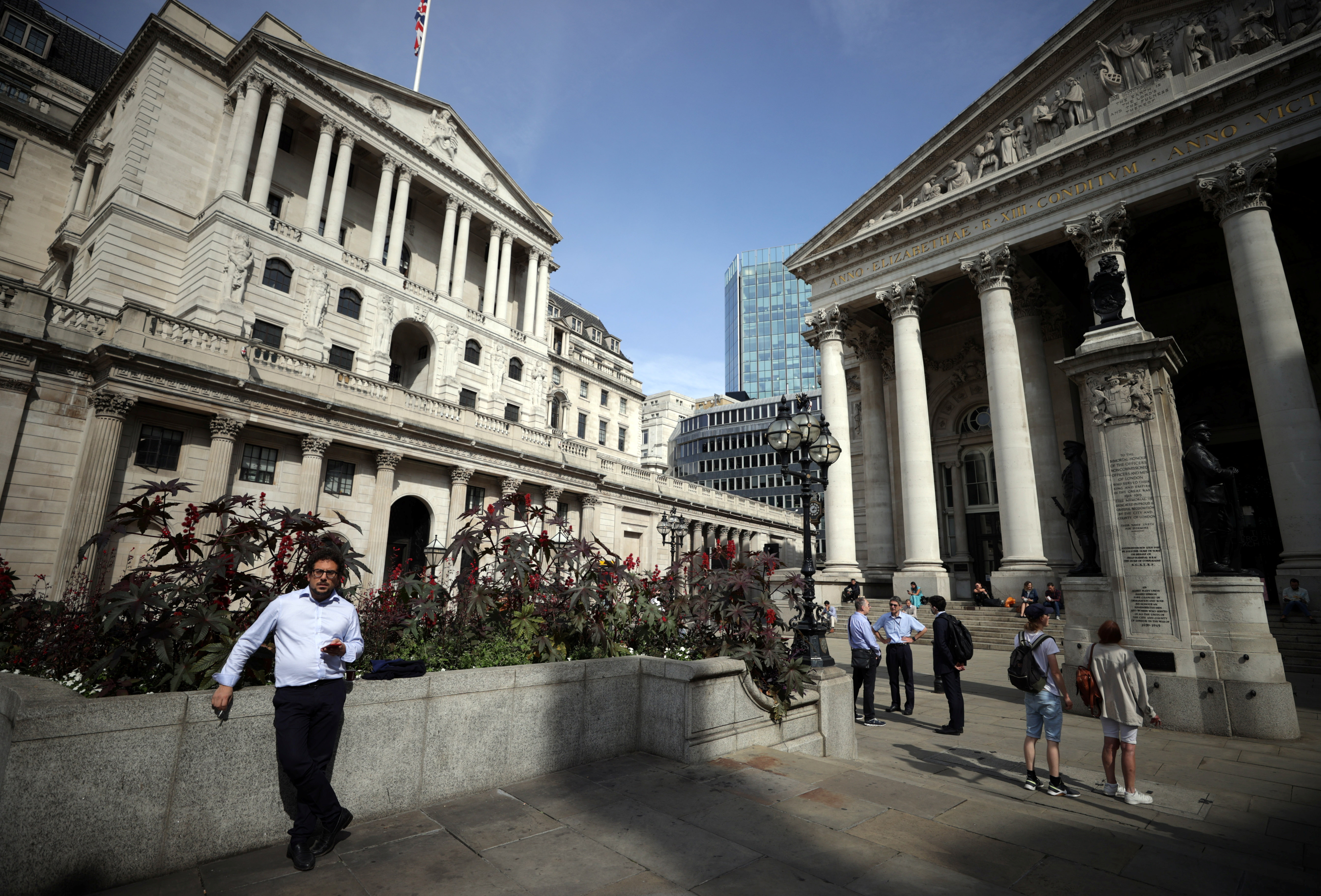 A person stands outside the Bank of England in London, Britain, September 13, 2021. REUTERS/Hannah McKay