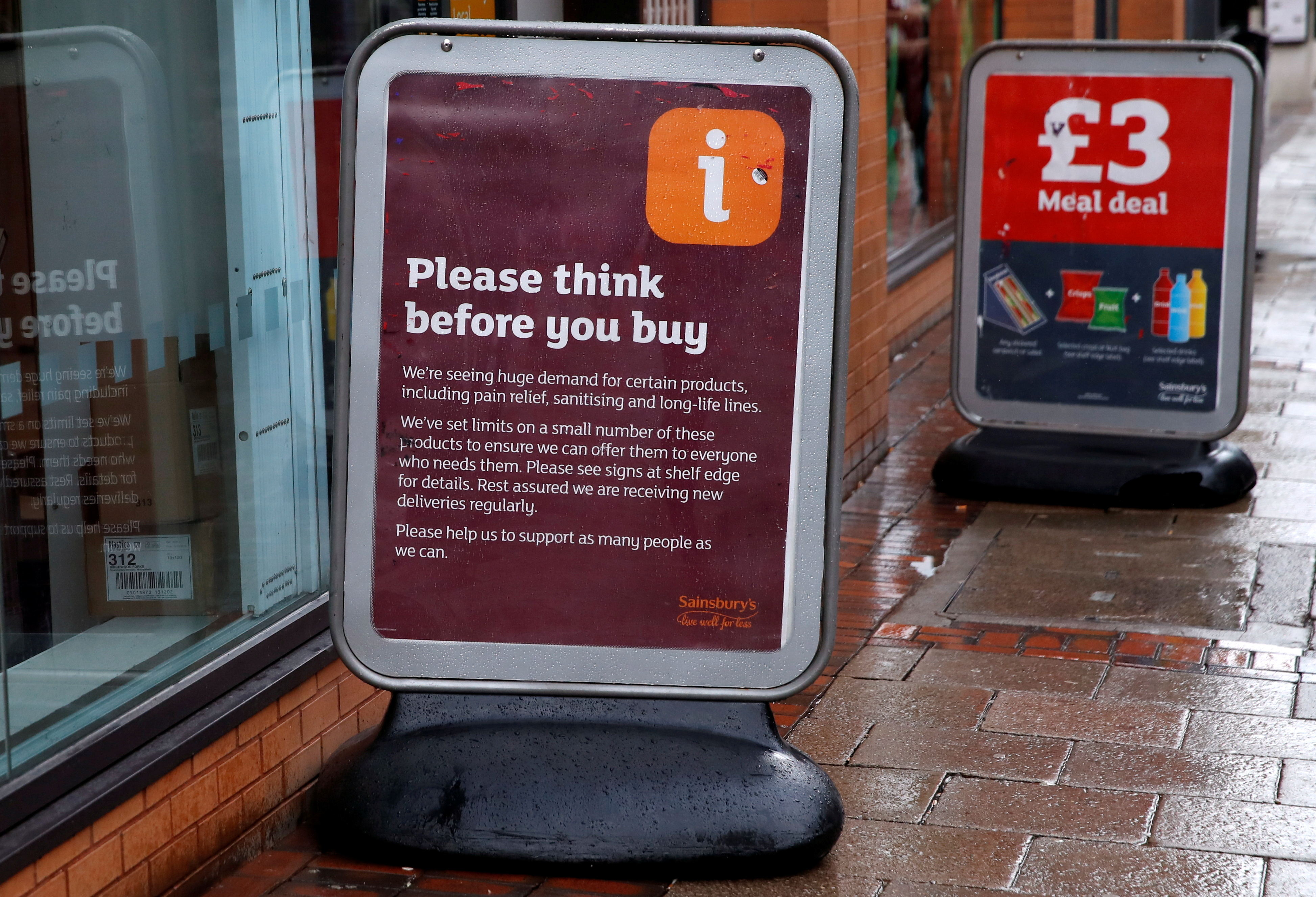 A general view of a sign warning customers of product shortages outside a Sainsbury's Local supermarket in central Birmingham, Britain, March 15, 2020 . REUTERS/Andrew Boyers/File Photo