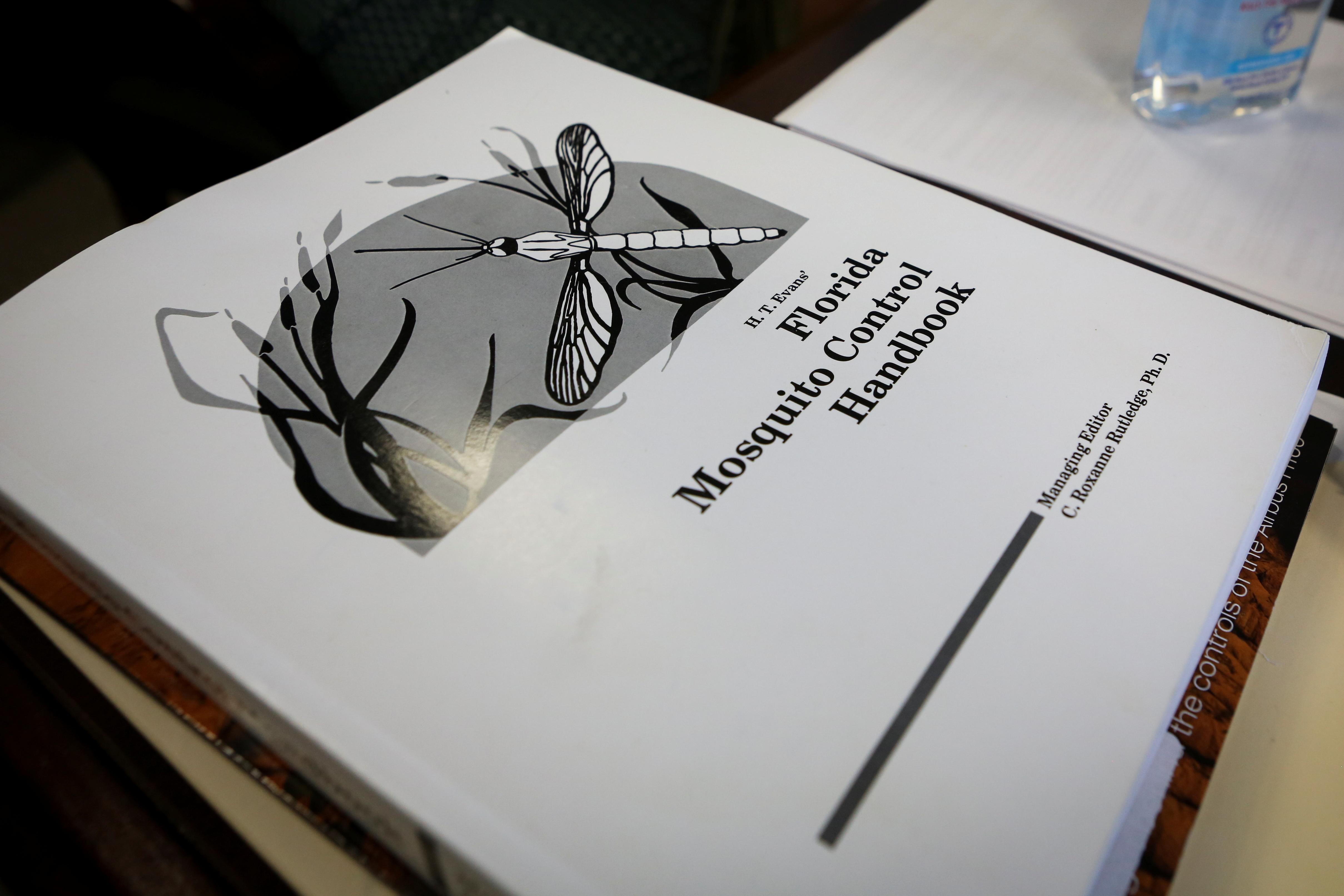 A handbook is seen at Florida Keys Mosquito Control District headquarters, in Marathon, Florida, U.S. May 4, 2021. REUTERS/Marco Bello