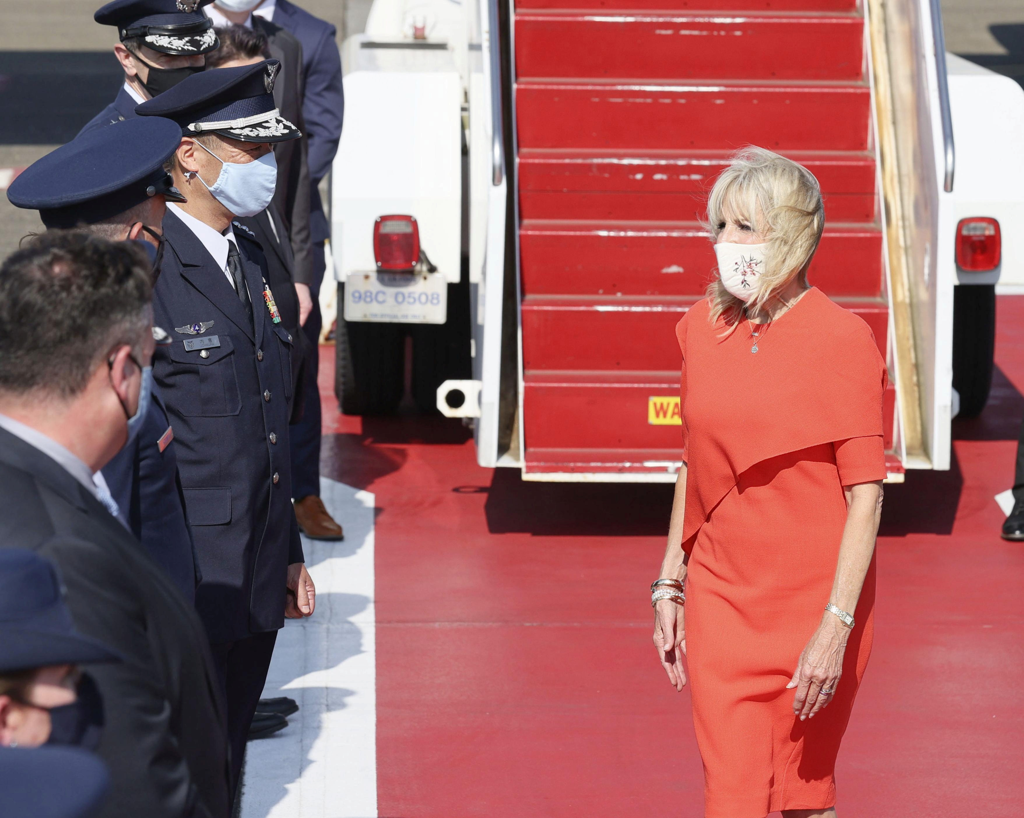 U.S. First Lady Jill Biden is greeted by Japanese and U.S delegates upon her arrival at Yokota Air Base for attending the opening ceremony of the Tokyo 2020 Olympic Games in Tokyo July 22, 2021, Japan, in this photo released by Kyodo. Mandatory credit Kyodo/via REUTERS