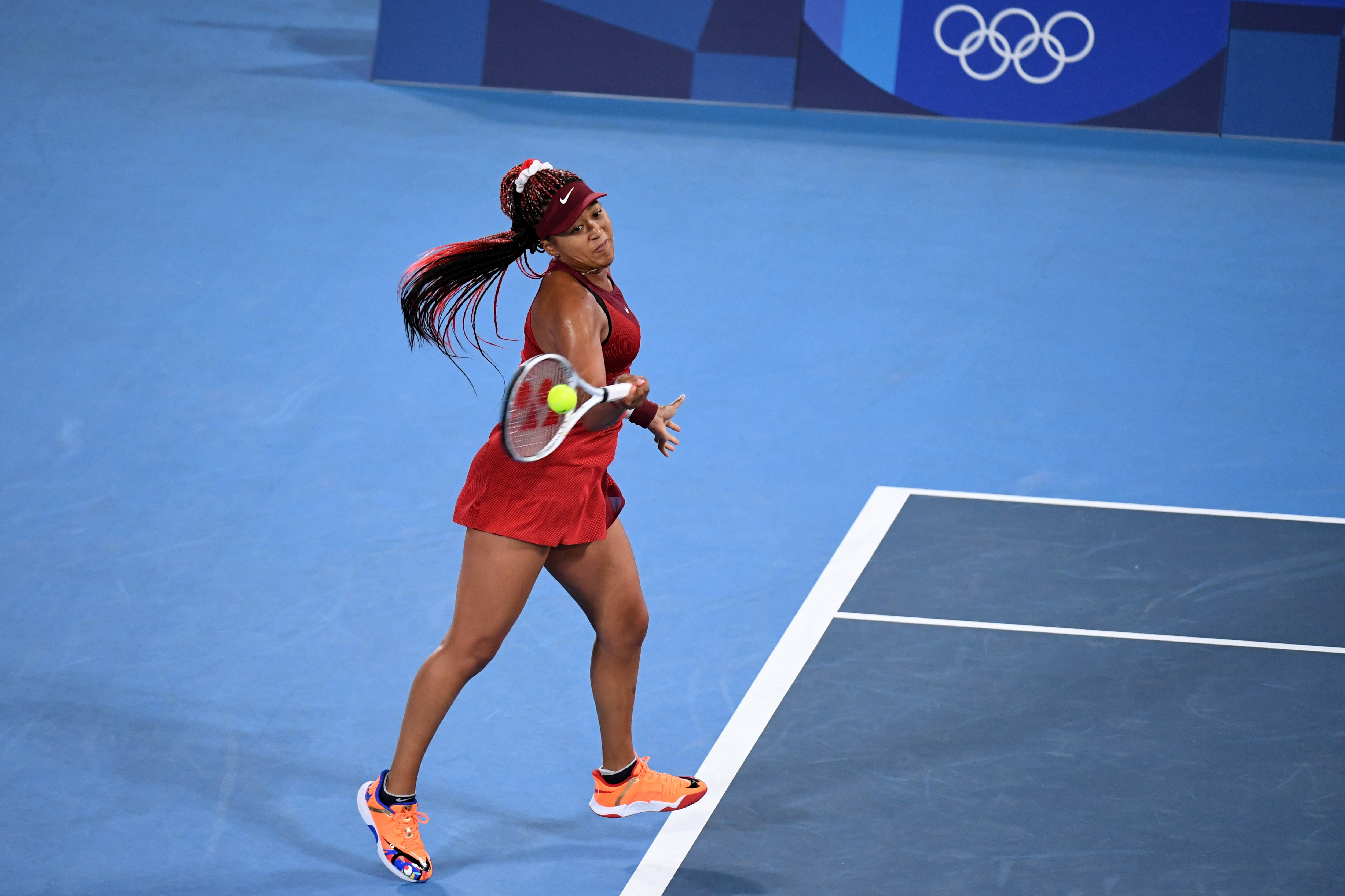 Tokyo 2020 Olympics - Tennis - Women's Singles - Round 3 - Ariake Tennis Park - Tokyo, Japan - July 27, 2021. Naomi Osaka of Japan in action during her third round match against Marketa Vondrousova of Czech Republic REUTERS/Piroschka Van De Wouw