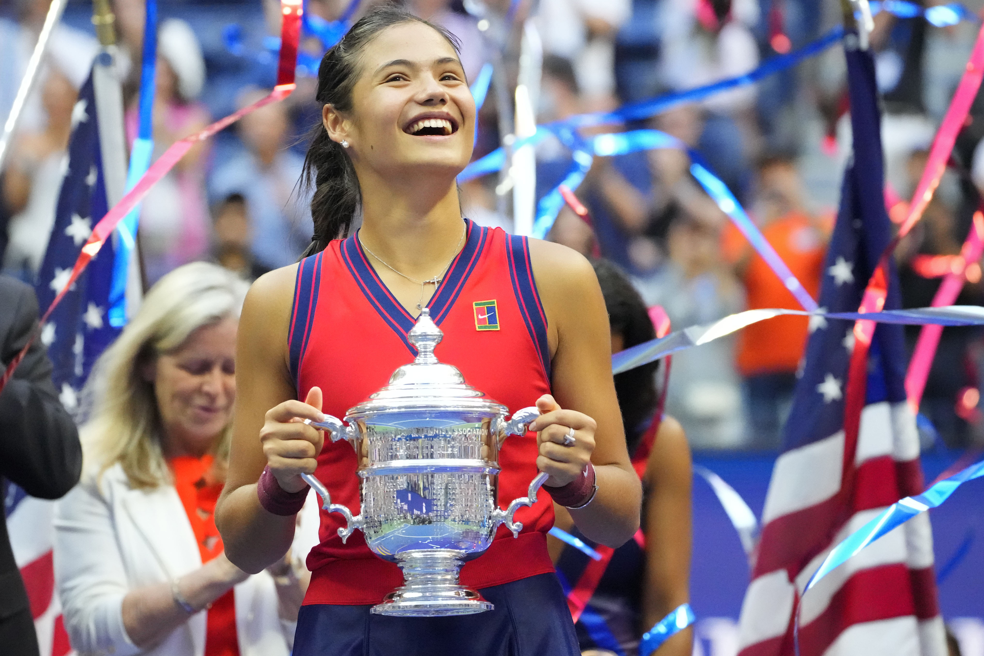 Sep 11, 2021; Flushing, NY, USA; Emma Raducanu of Great Britain celebrates with the championship trophy after her match against Leylah Fernandez of Canada (not pictured) in the women's singles final on day thirteen of the 2021 U.S. Open tennis tournament at USTA Billie Jean King National Tennis Center. Mandatory Credit: Robert Deutsch-USA TODAY Sports