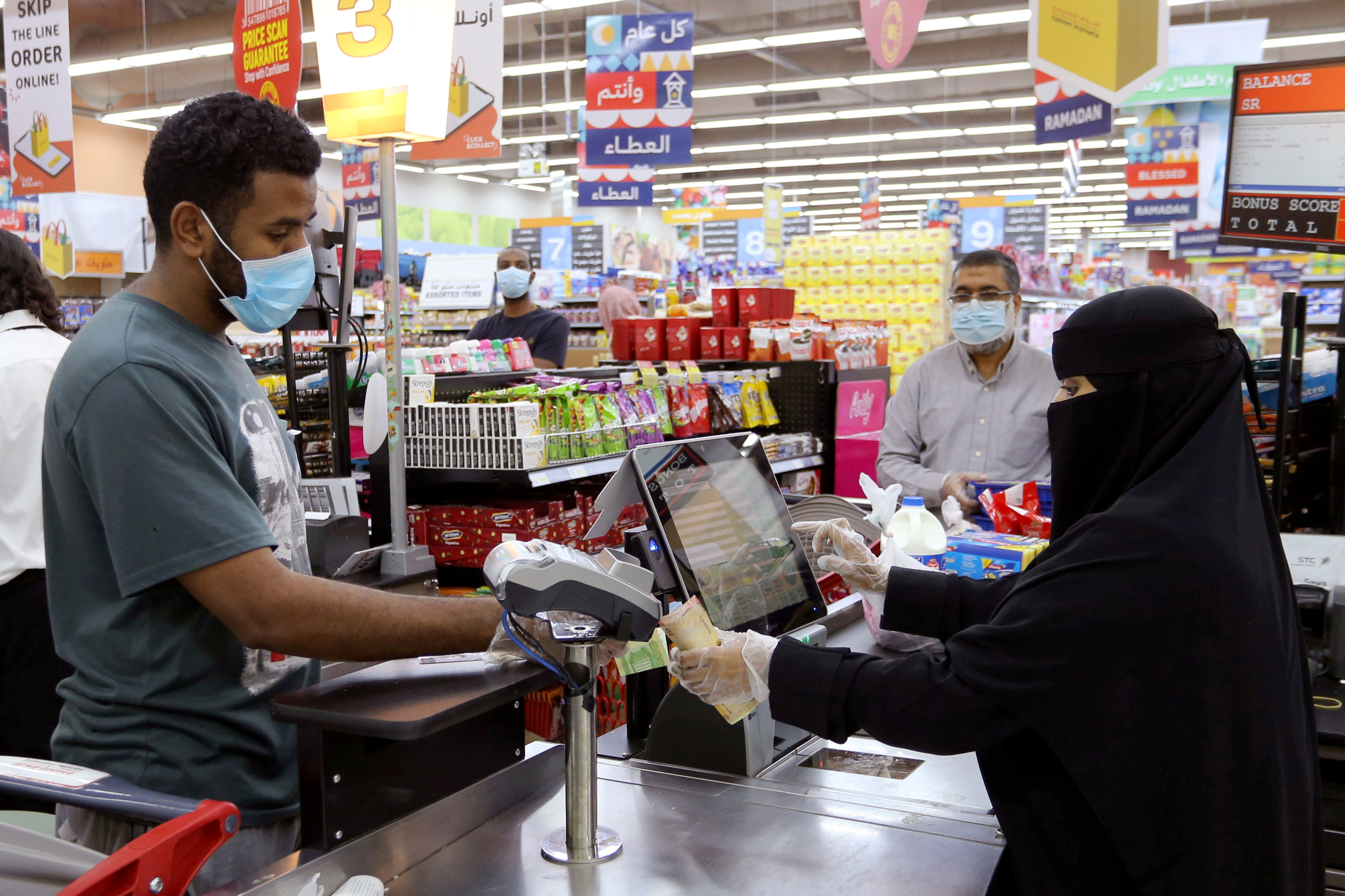 People wearing protective face masks and gloves shop at a supermarket, following the outbreak of the coronavirus disease (COVID-19), in Riyadh, Saudi Arabia May 11, 2020. REUTERS/Ahmed Yosri/File Photo