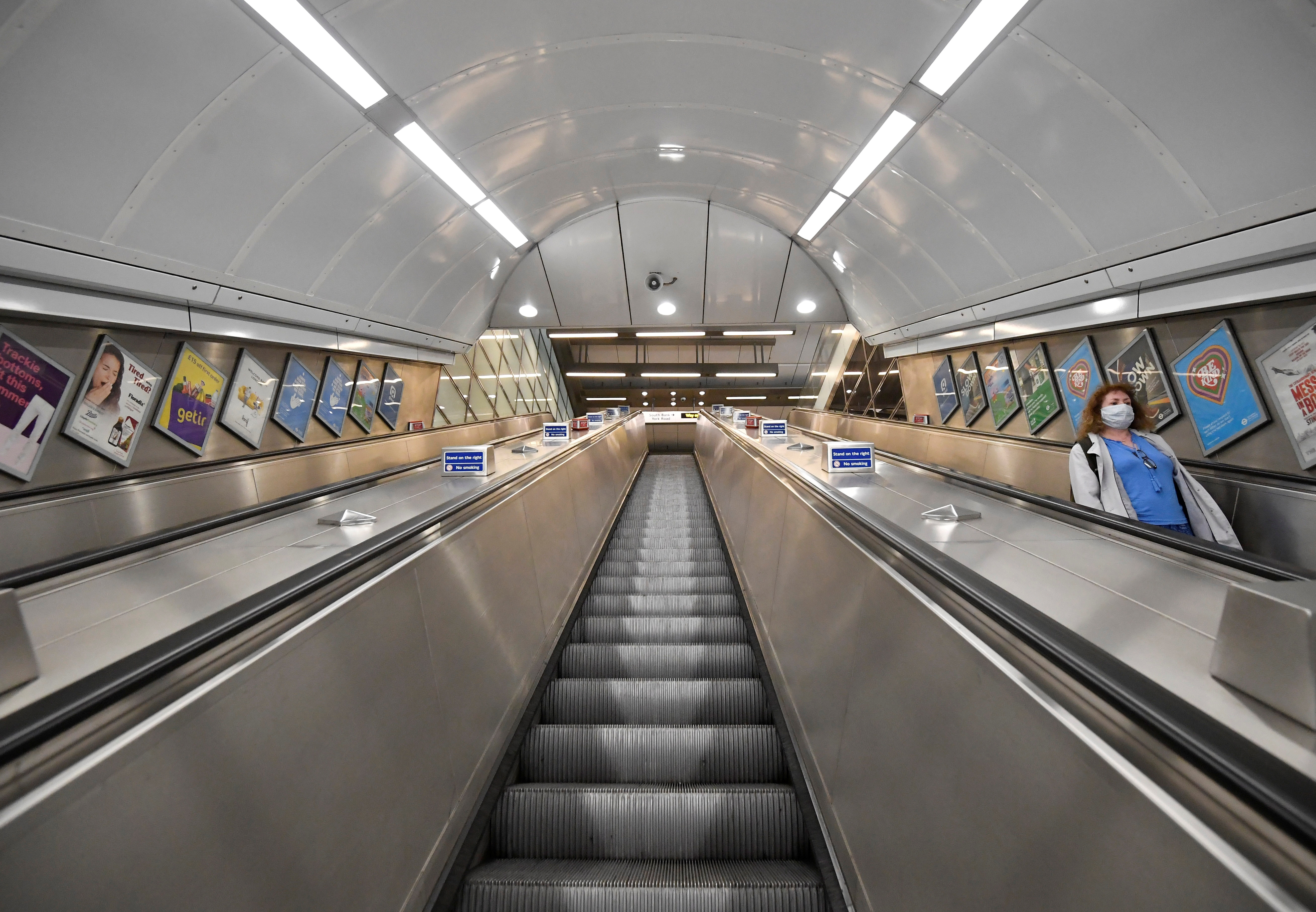 A passenger takes escalators on the London Underground tube train network, as lockdown restrictions continue to ease amidst the spread of the coronavirus disease (COVID-19) pandemic, in London, Britain May 28, 2021. REUTERS/Toby Melville