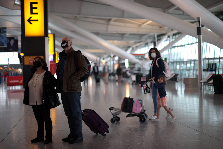Passengers walk at the Terminal 5 departures area at Heathrow Airport in London, Britain, June 10, 2021. REUTERS/Hannah McKay