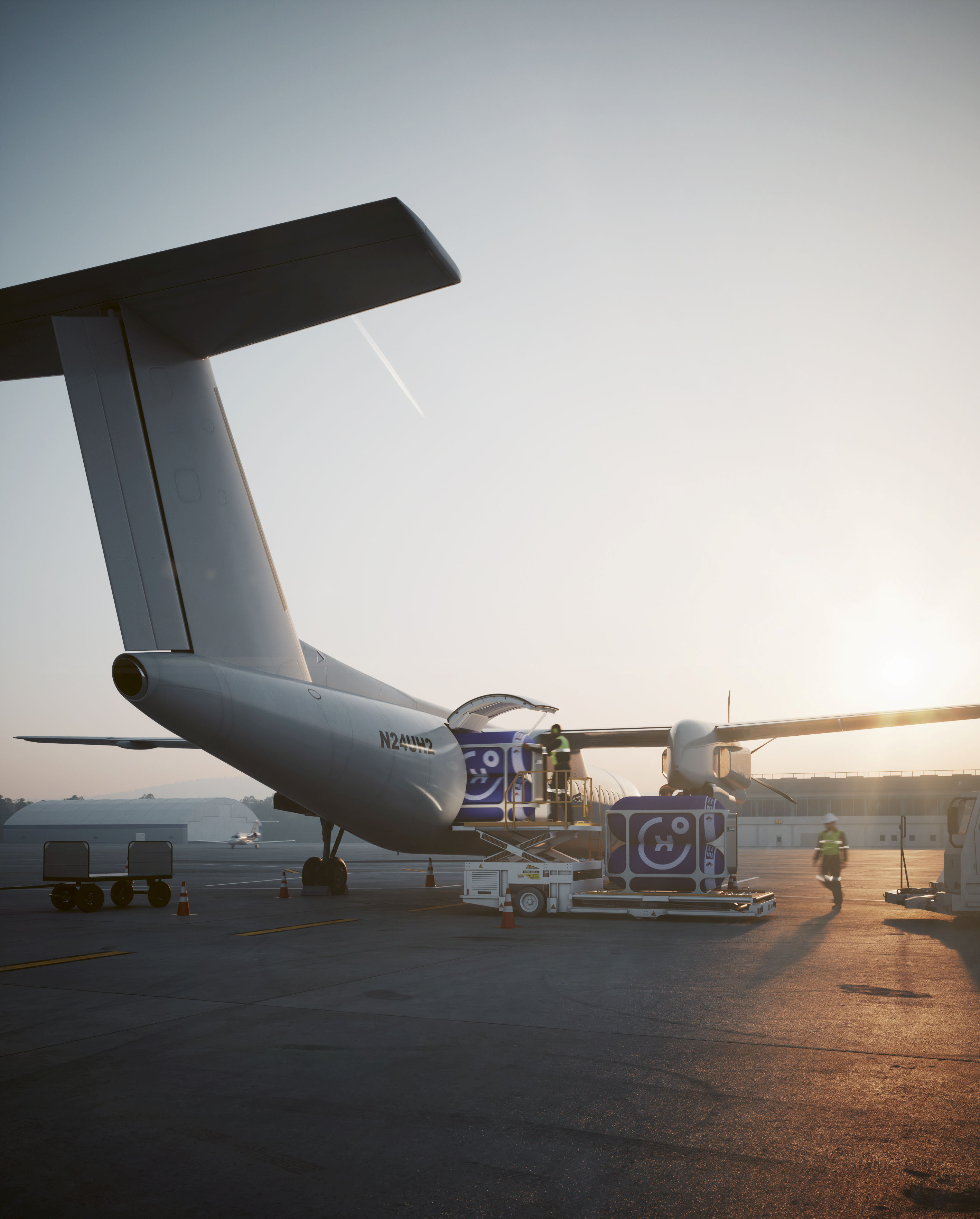 Modular hydrogen capsules are loaded on a regional aircraft in this rendering dated 2020 supplied by Universal Hydrogen. The U.S.-based company plans to use the capsules to transport hydrogen needed to run a carbon-free power system based on fuel cells. Courtesy Universal Hydrogen/Handout via REUTERS