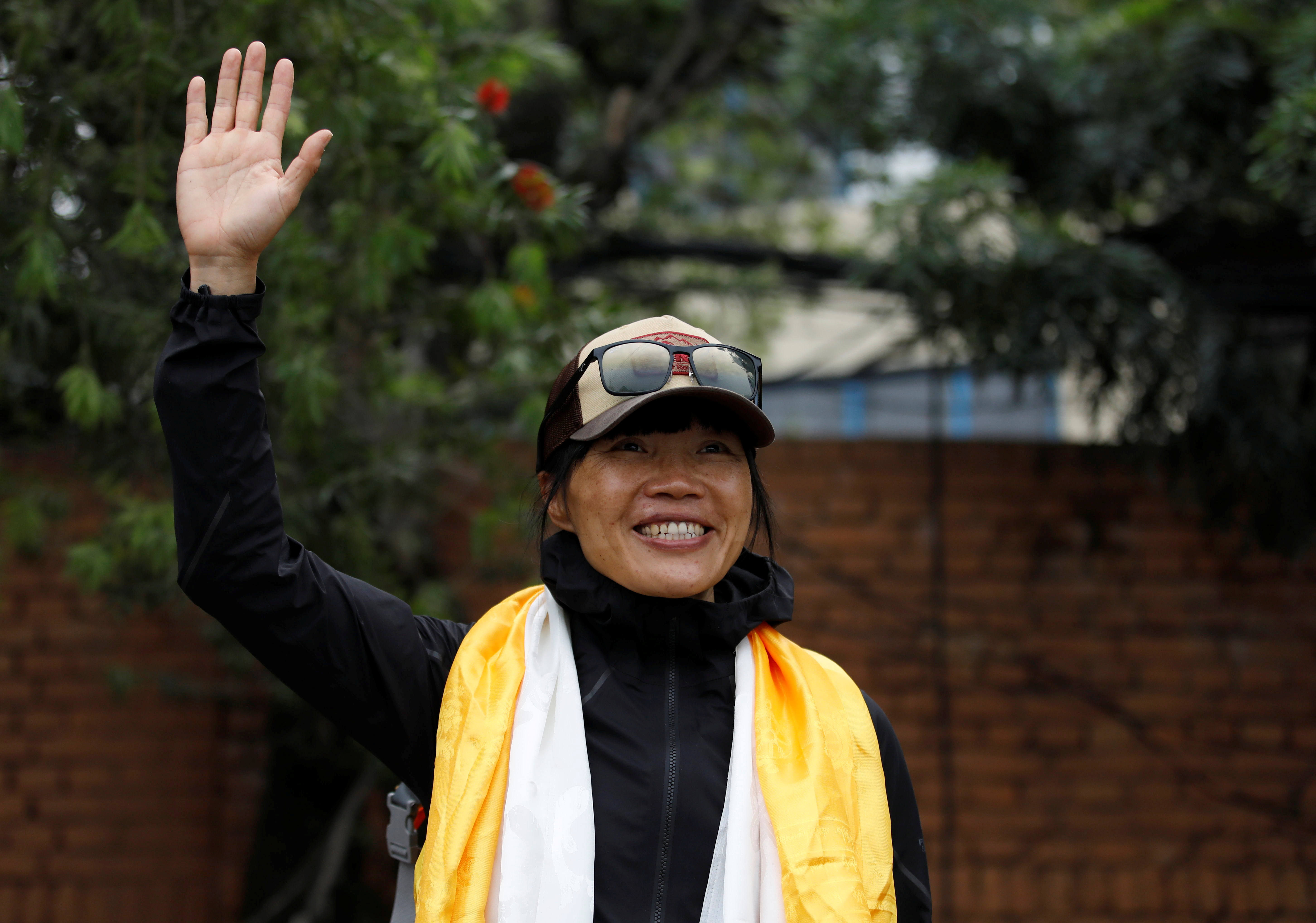 Hong Kong's Tsang Yin-Hung, 45, who scaled Mount Everest in less than 26 hours, the shortest time taken by any woman after starting from the base camp, waves for a picture upon her arrival after climbing Everest, in Kathmandu, Nepal May 30, 2021. REUTERS/Navesh Chitrakar