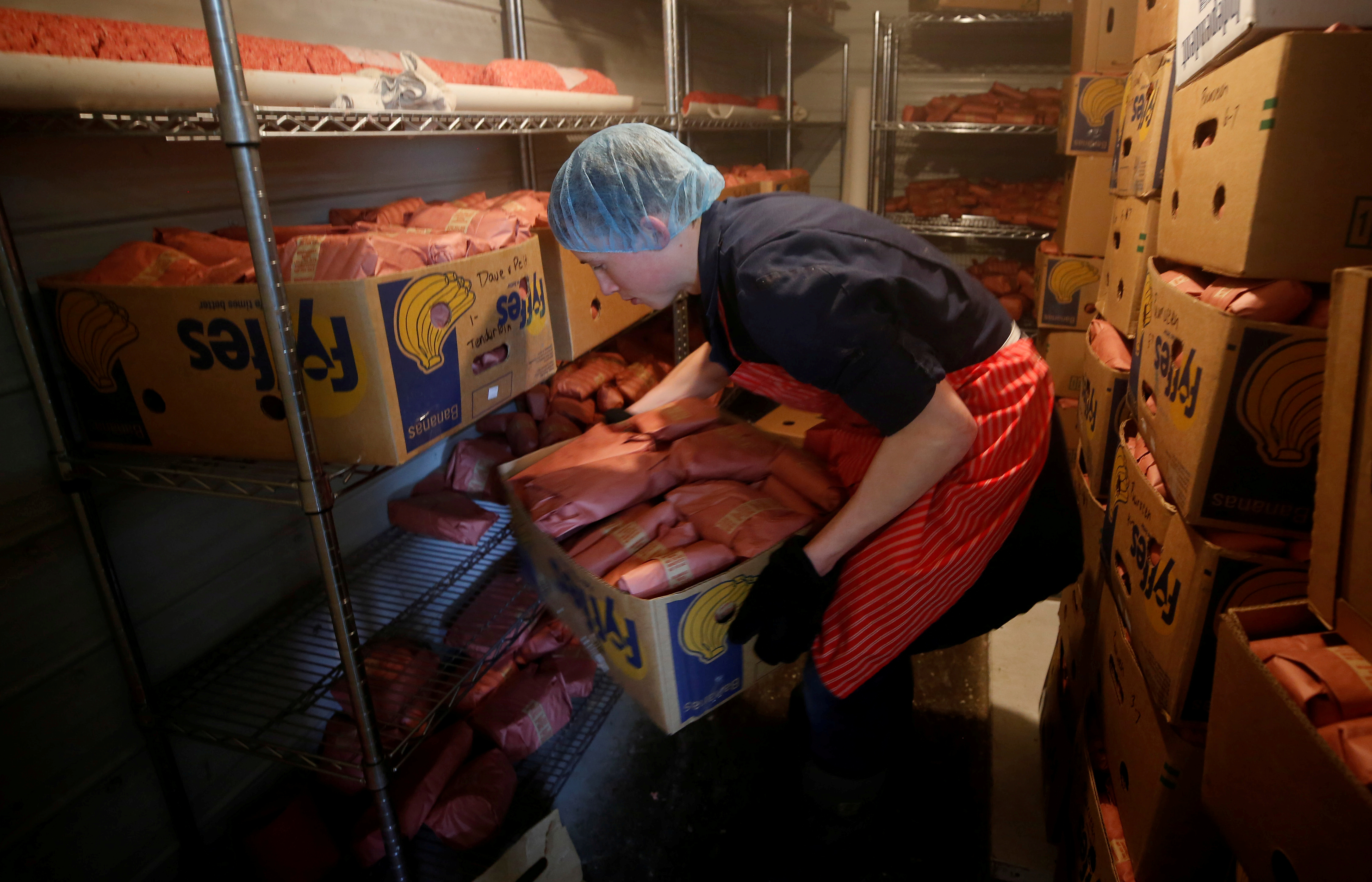 Butcher Allan vande Bruinhorst freezes beef as part of his uncle's business which allows farmers to circumvent the supply chain blockage caused by coronavirus disease (COVID-19) outbreaks at meatpacking plants, in Picture Butte, Alberta, Canada June 17, 2020. REUTERS/Todd Korol/File Photo