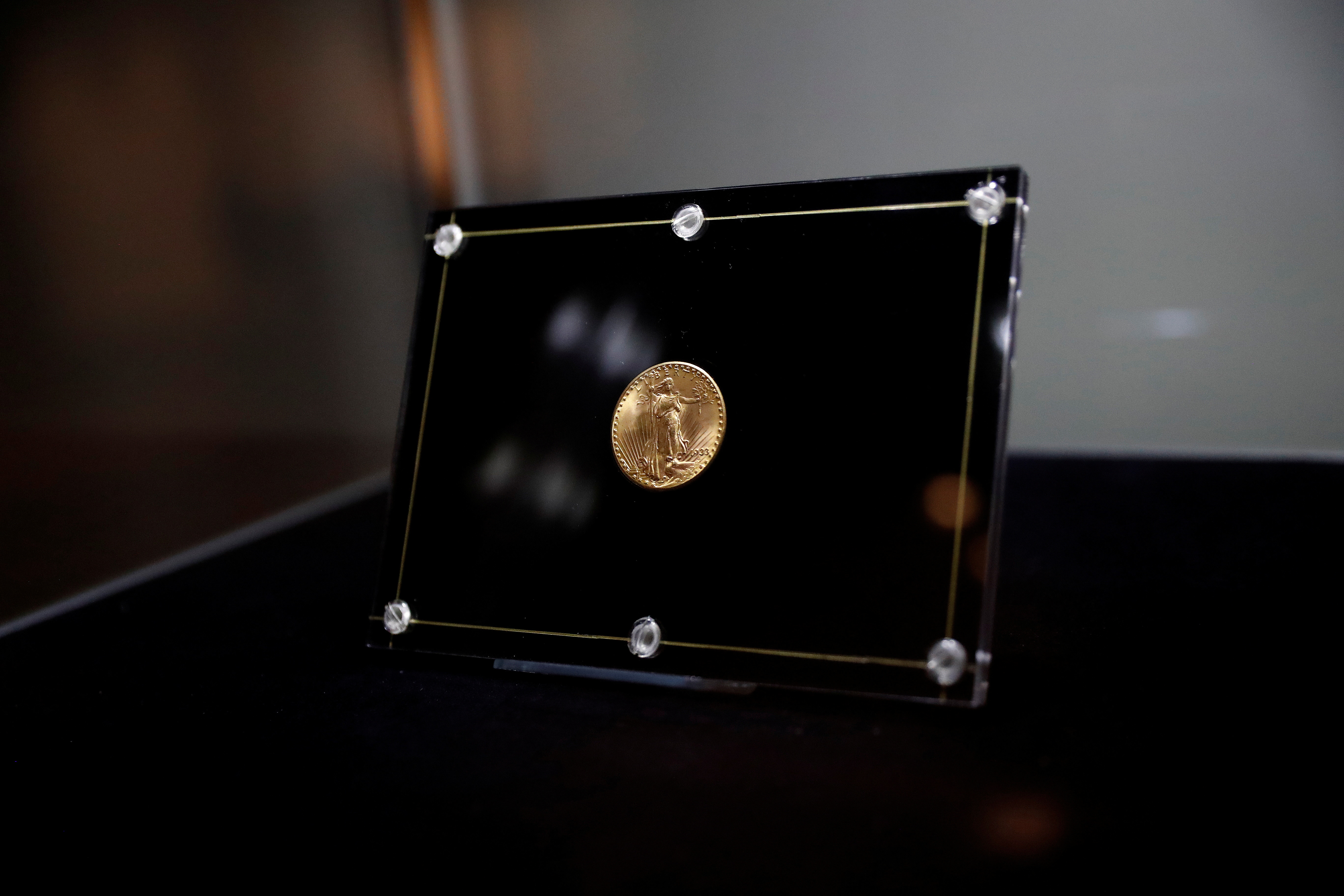 The 1933 Double Eagle coin is seen encased during a media preview before auction at Sotheby's in New York City, U.S., June 4, 2021. REUTERS/Shannon Stapleton/File Photo