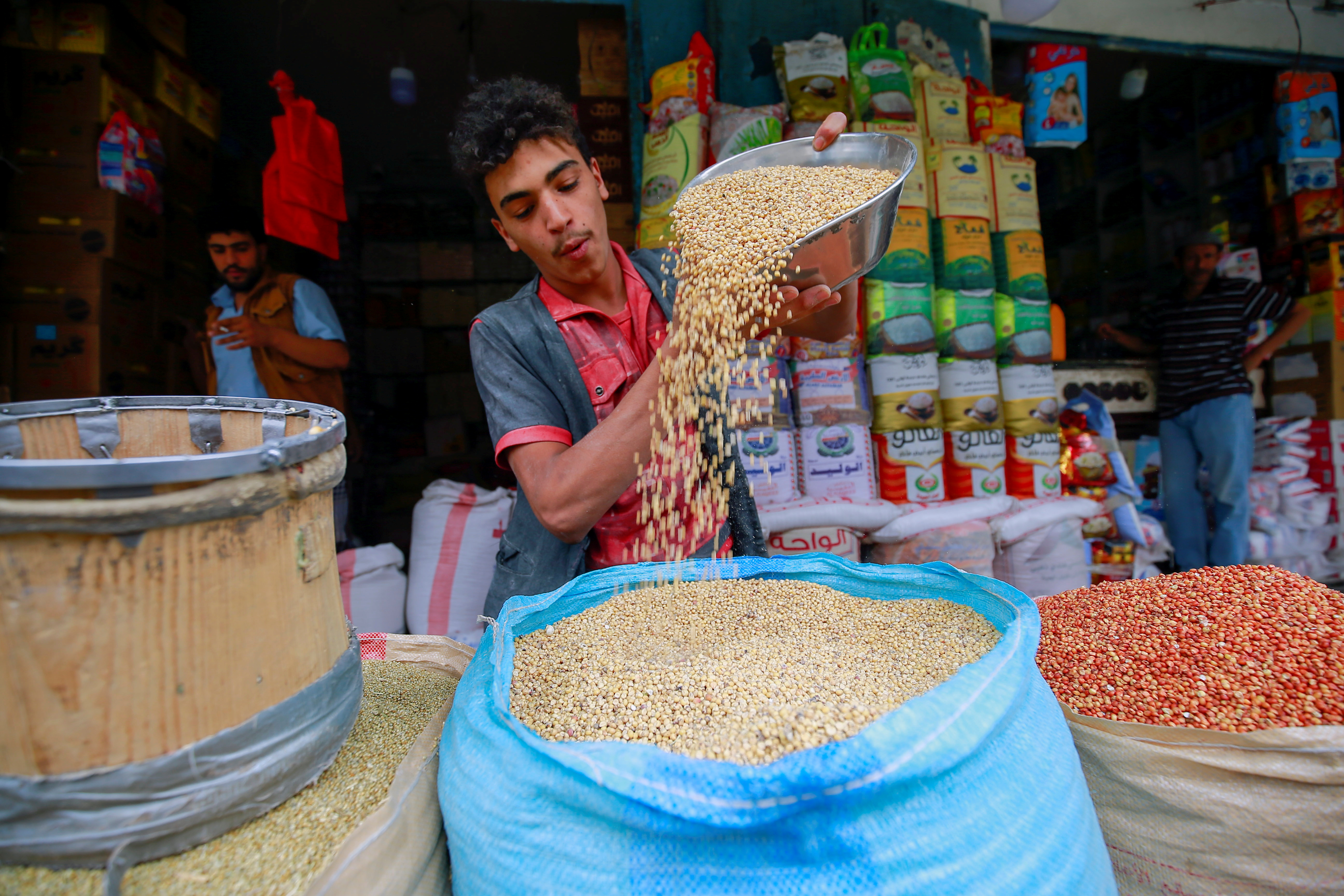 A spices vendor displays grains at his shop in Sanaa, Yemen June 28, 2021. Picture taken June 28, 2021. REUTERS/Nusaibah Almuaalemi