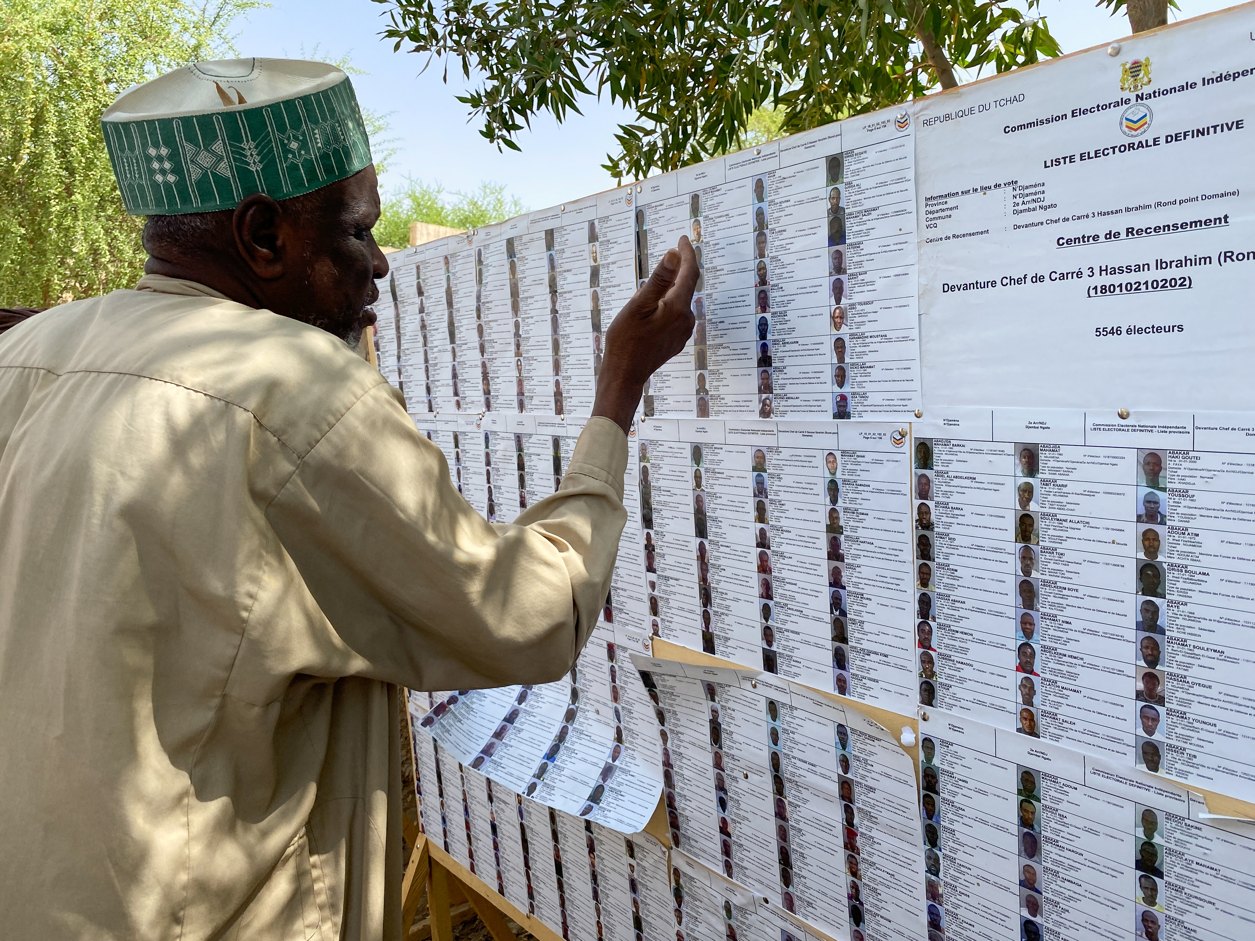 A man searches for his name on a registration list at a polling station during the presidential election in N'Djamena, Chad April 11, 2021. REUTERS/ Media Coulibaly