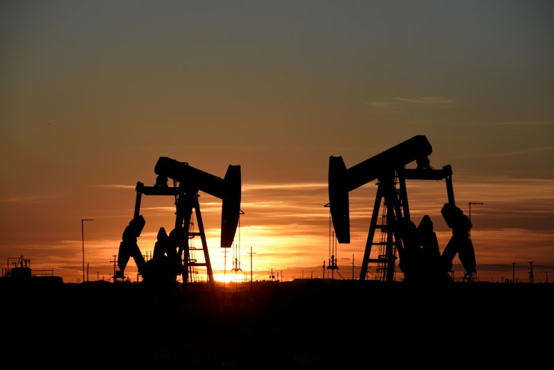 Pump jacks operate at sunset in an oil field in Midland, Texas U.S. August 22, 2018. REUTERS/Nick Oxford