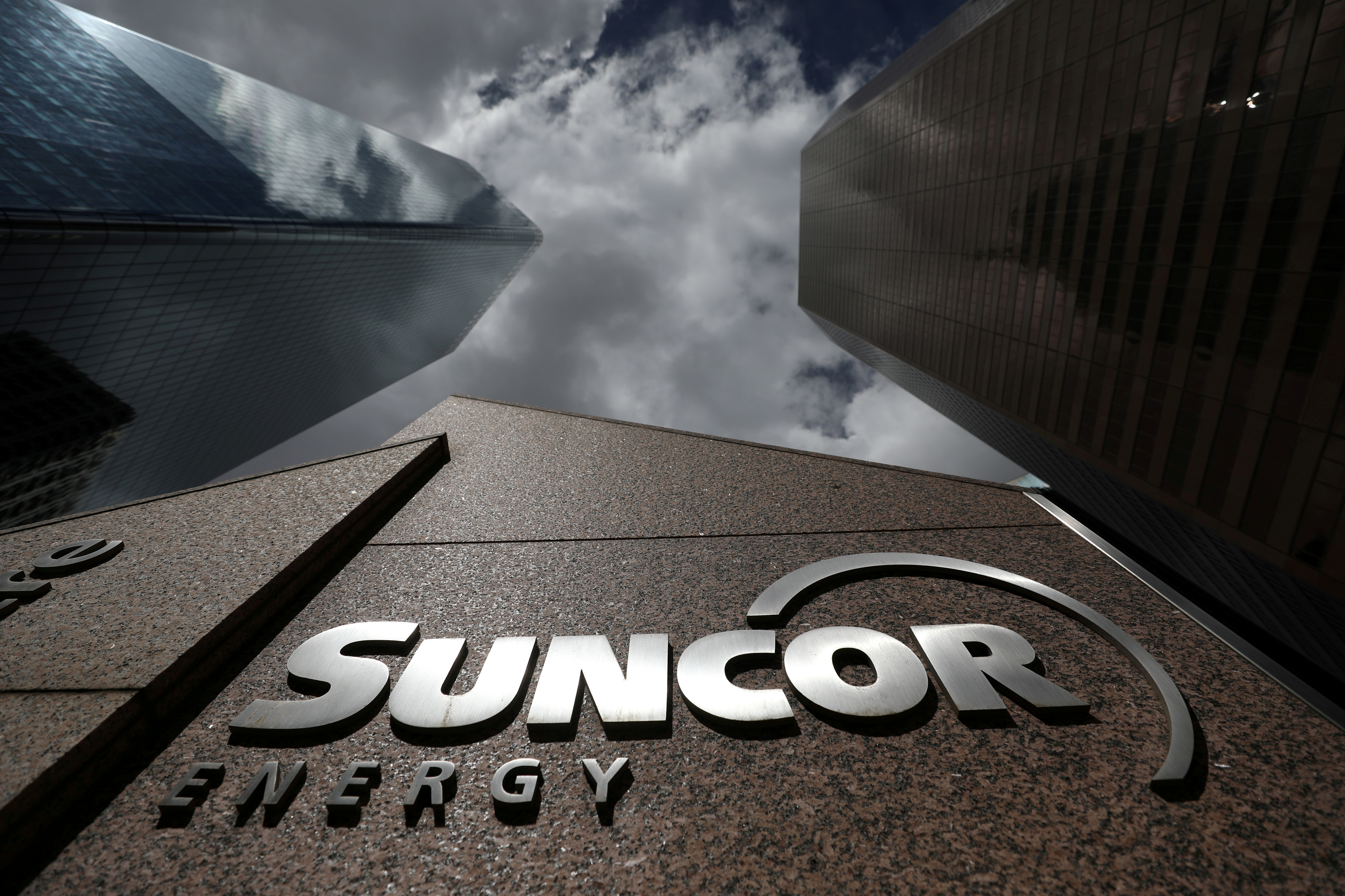 FILE PHOTO: The Suncor Energy logo is seen at their head office in Calgary, Alberta, Canada, April 17, 2019. REUTERS/Chris Wattie