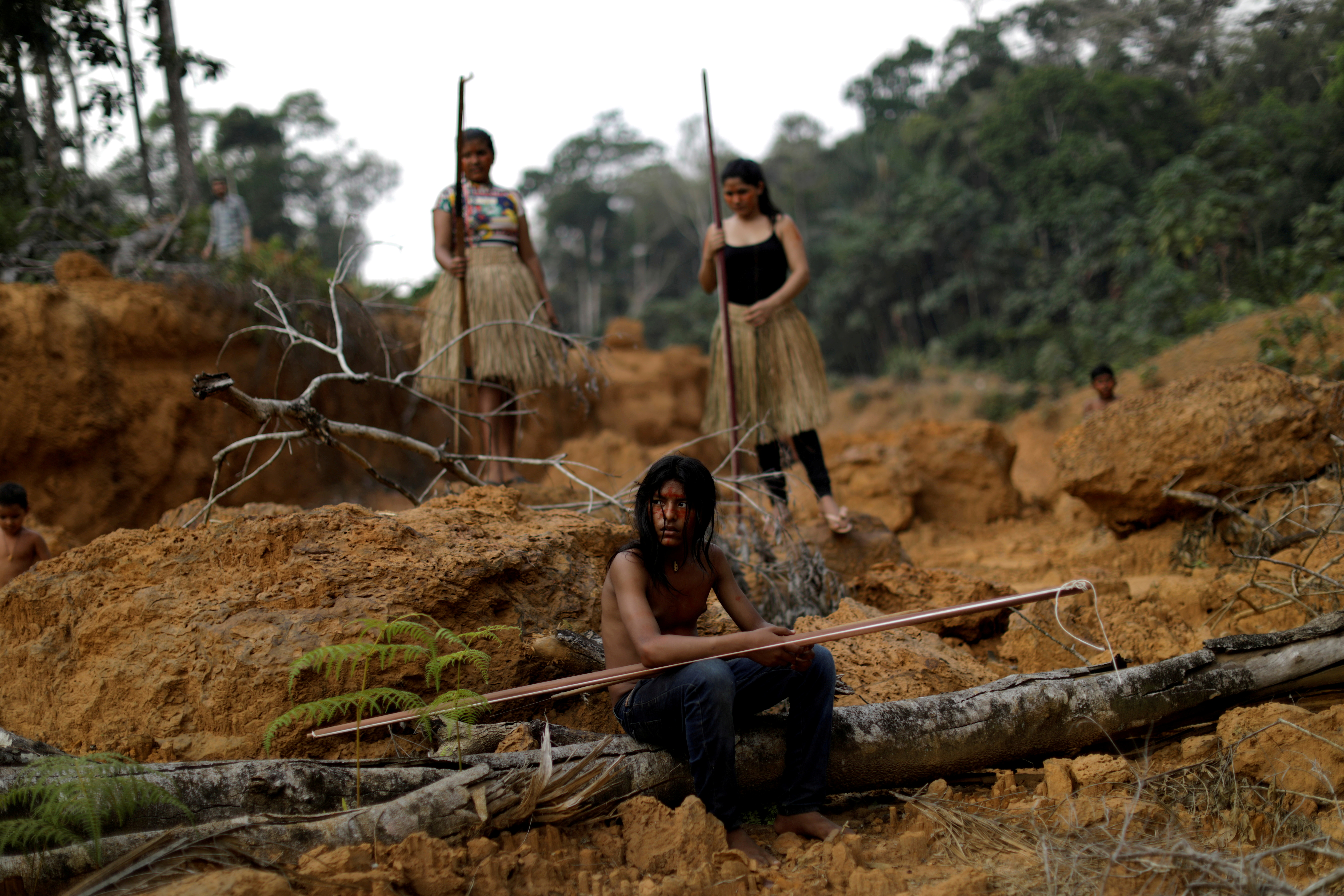 Indigenous people from the Mura tribe show a deforested area in unmarked indigenous lands, inside the Amazon rainforest near Humaita, Amazonas State, Brazil August 20, 2019. REUTERS/Ueslei Marcelino