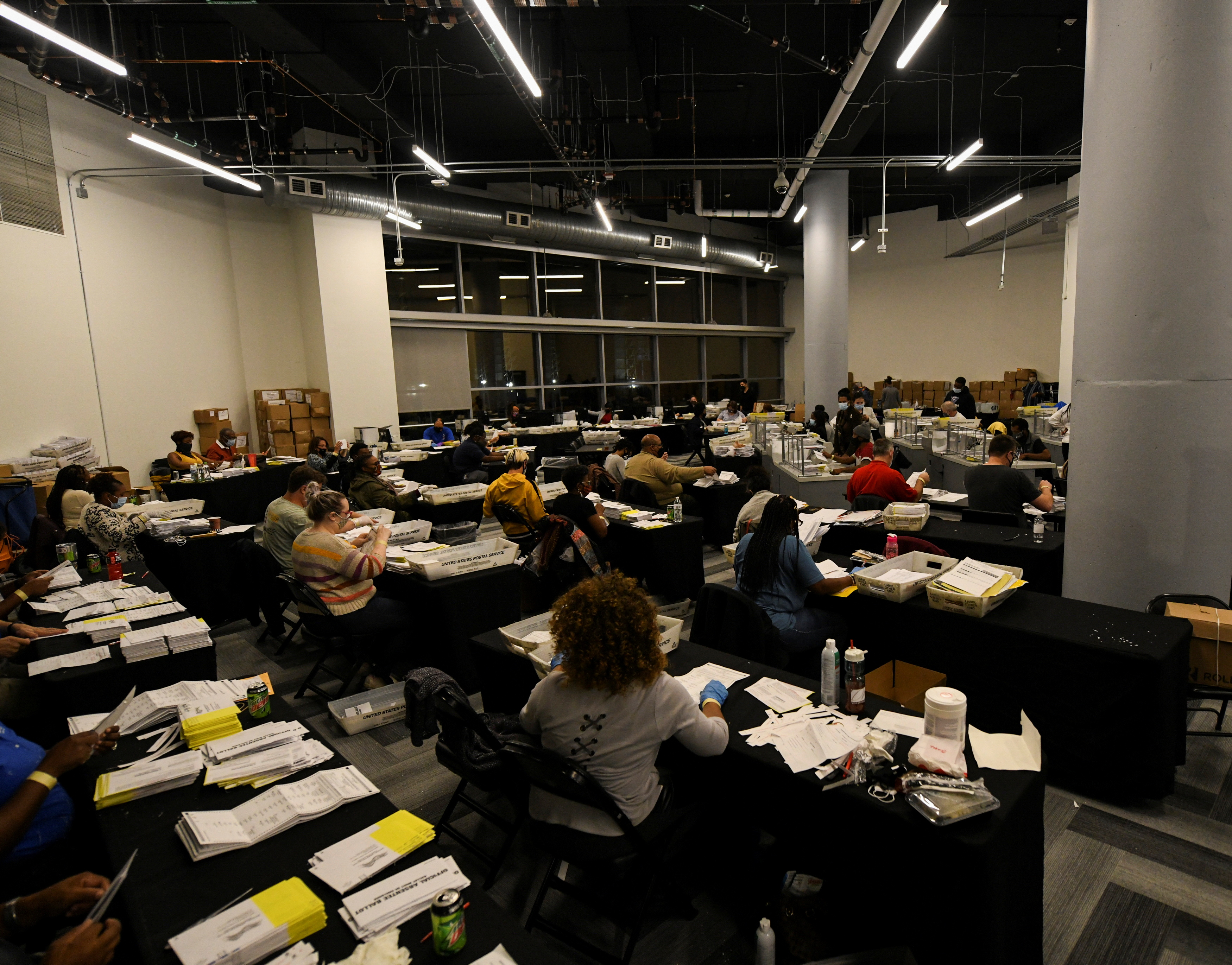 Employees of the Fulton County Board of Registration and Elections process ballots in Atlanta, Georgia U.S., November 4, 2020. REUTERS/Brandon Bell
