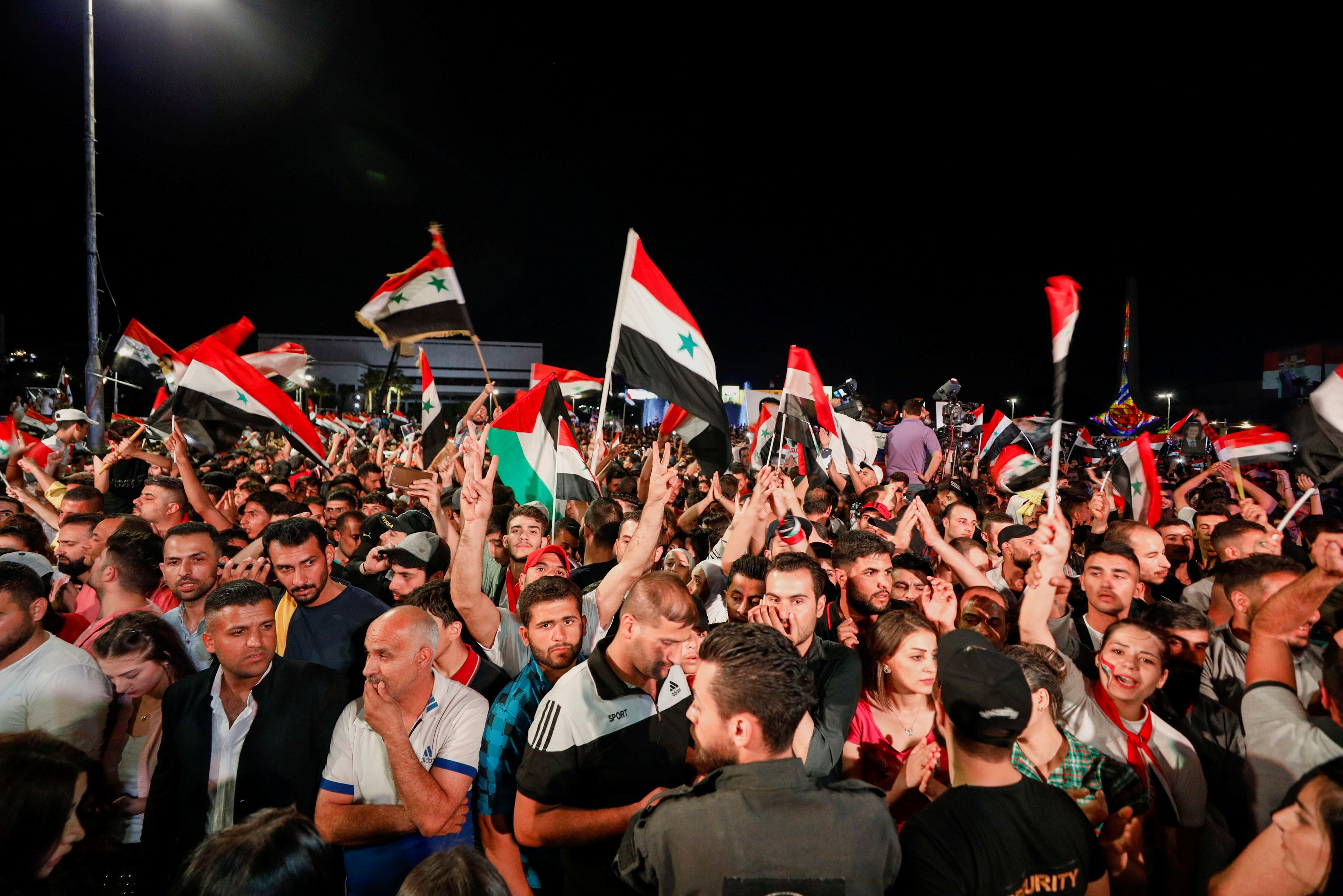 Supporters of Syria's President Bashar al-Assad celebrate before the results of the presidential election in Damascus, Syria, May 27, 2021. REUTERS/Omar Sanadiki