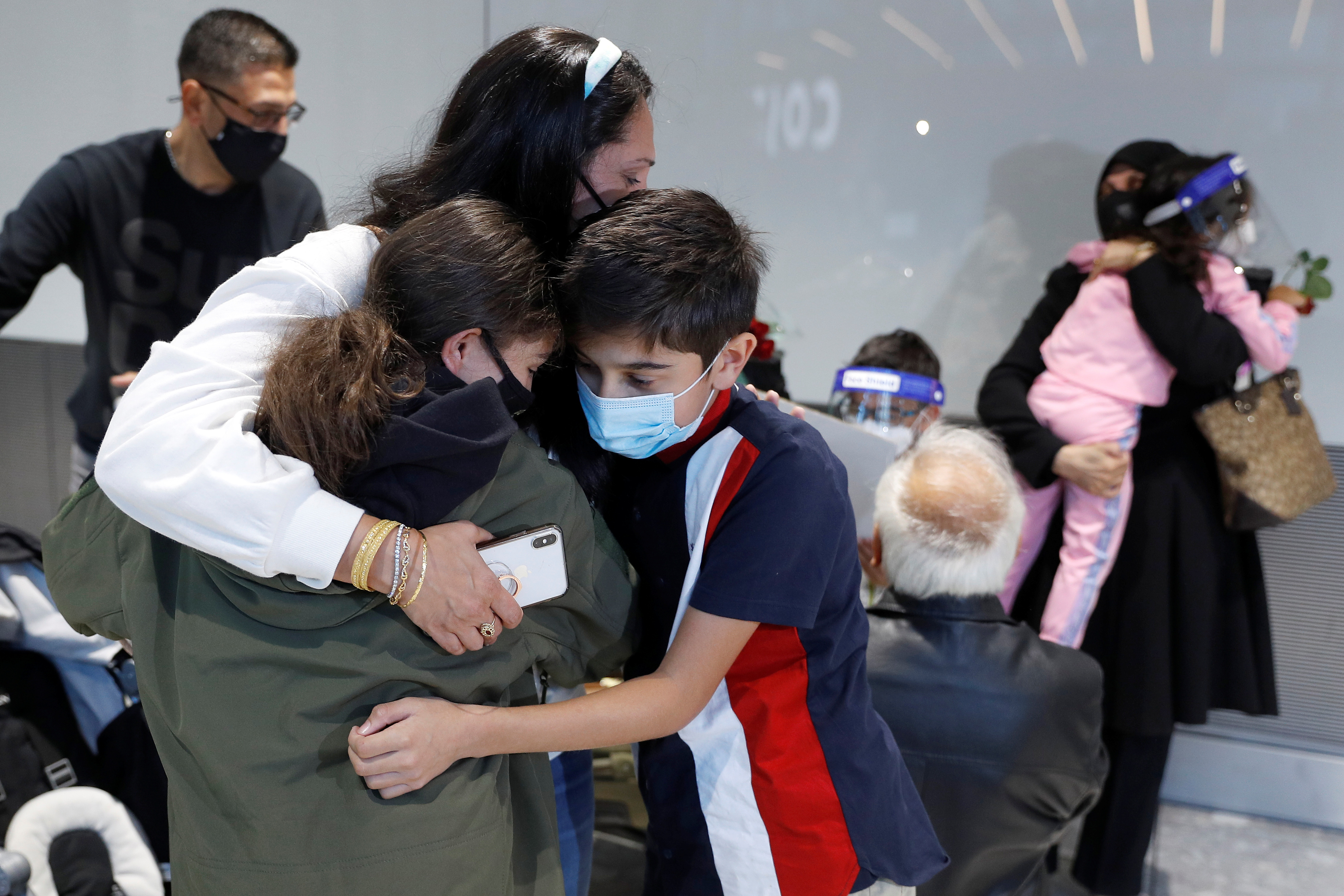People meeting family members from Charlotte in the U.S. embrace at the International arrivals area of Terminal 5 in London's  Heathrow Airport, Britain, August 2, 2021.  REUTERS/Peter Nicholls