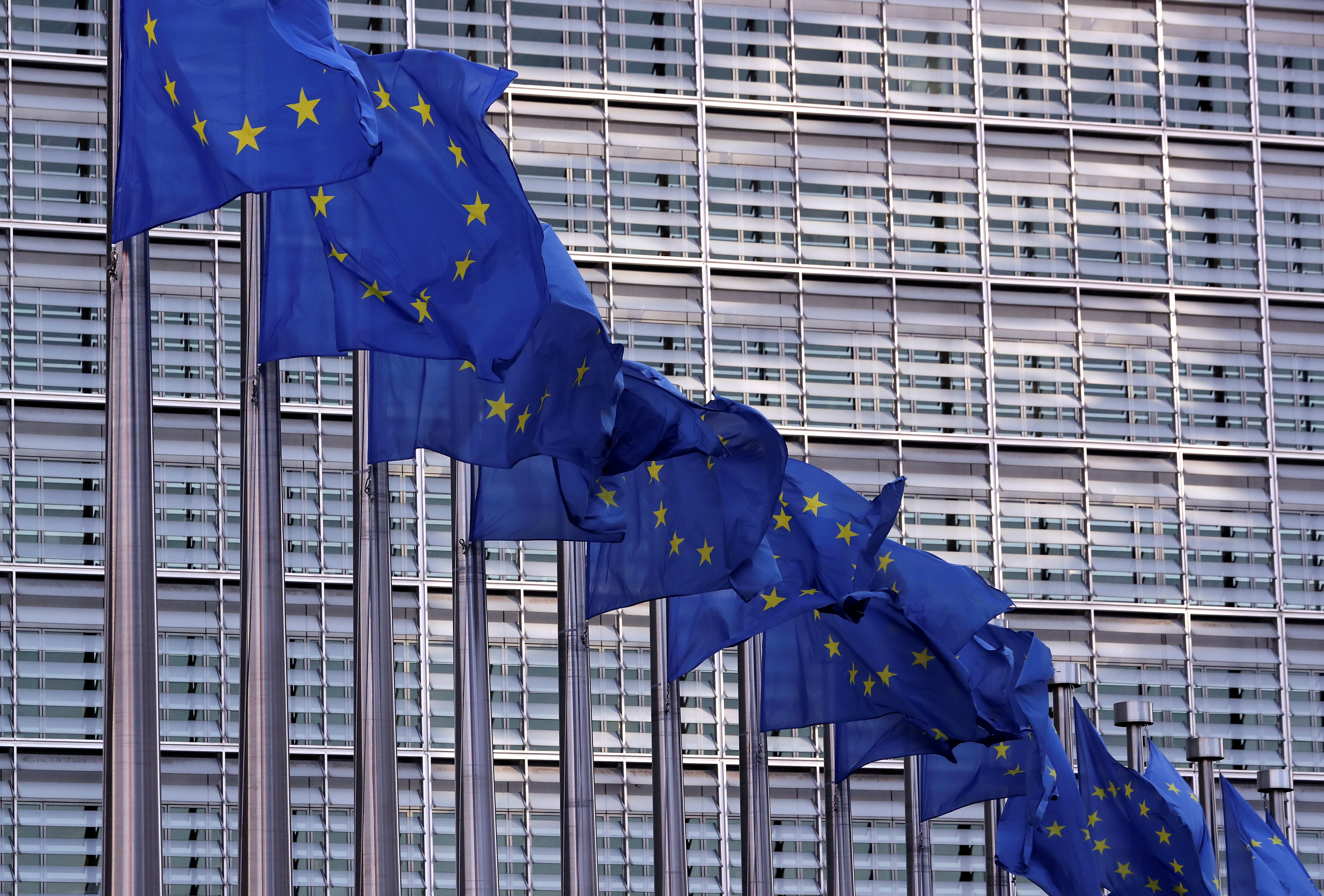 European Union flags fly outside the European Commission headquarters in Brussels, Belgium, February 19, 2020. REUTERS/Yves Herman/File Photo
