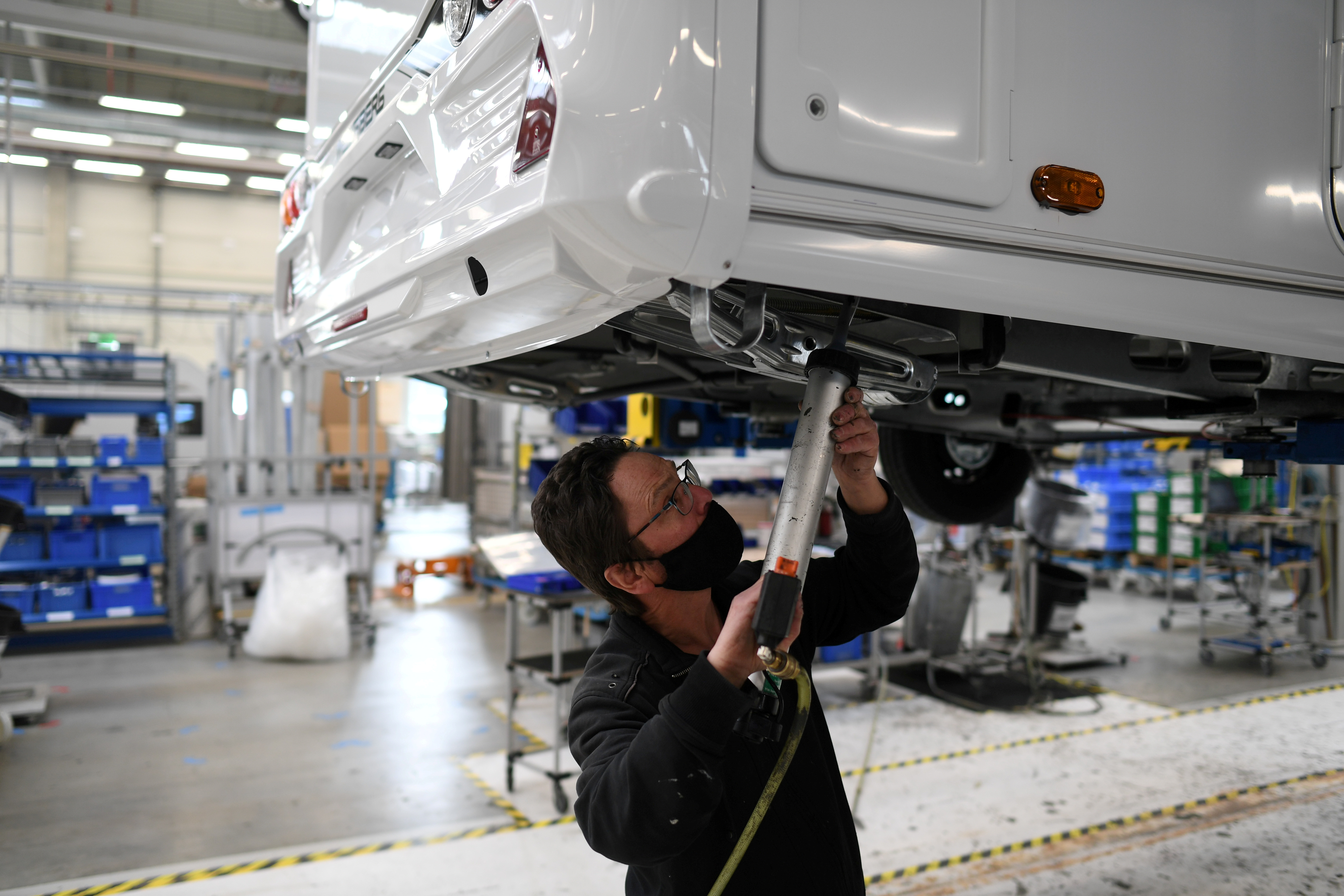 A worker assembles a vehicle at the Knaus-Tabbert AG factory in Jandelsbrunn near Passau, Germany, March 16, 2021. REUTERS/Andreas Gebert