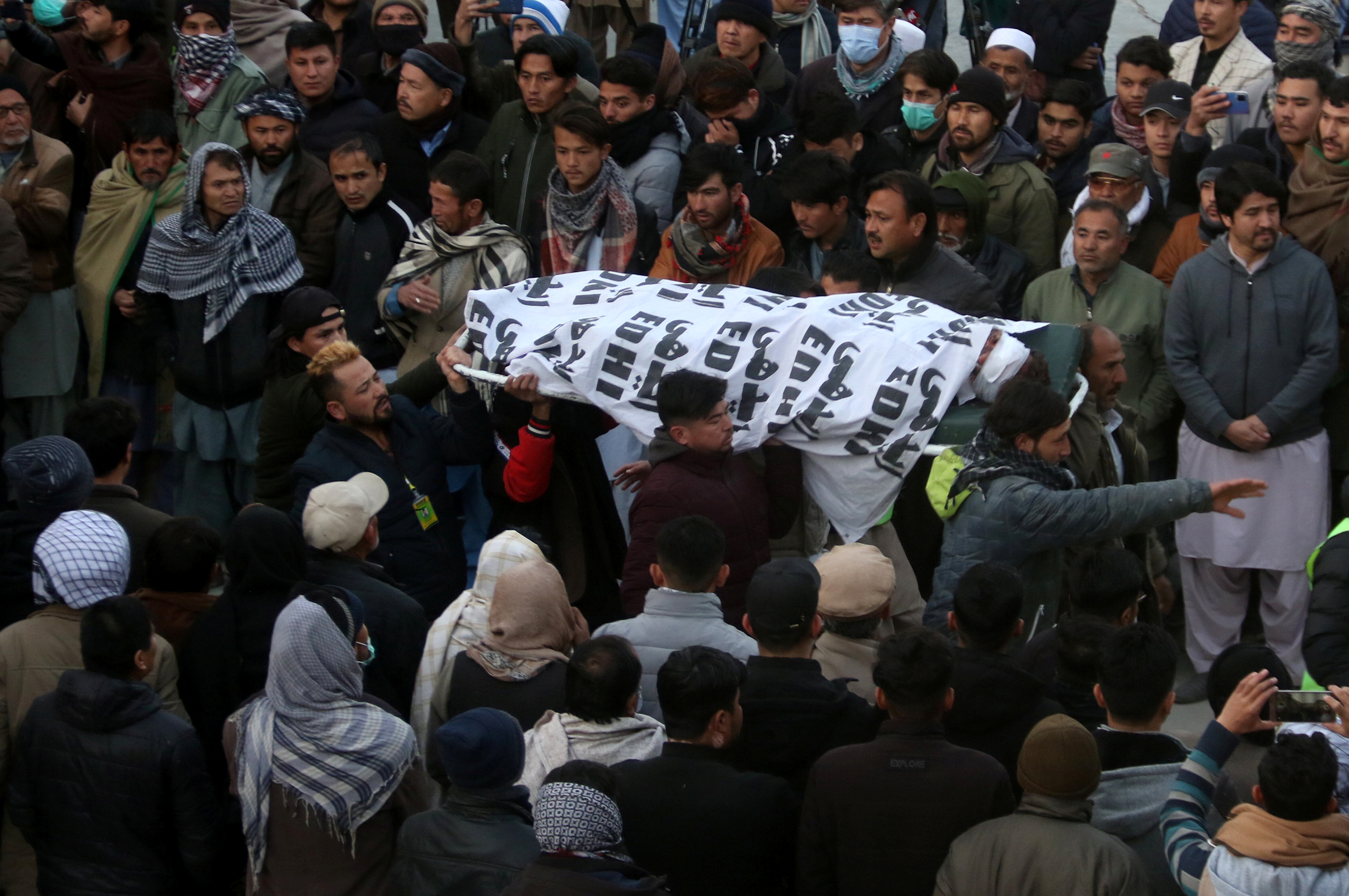 People and family members carry a body of their relative, who was a coal miner and got killed along with other coworkers from Pakistan's minority Shi'ite Hazara community by unidentifyed persons in Mach area of Bolan district, in Quetta, Pakistan January 3, 2021. REUTERS/Naseer Ahmed